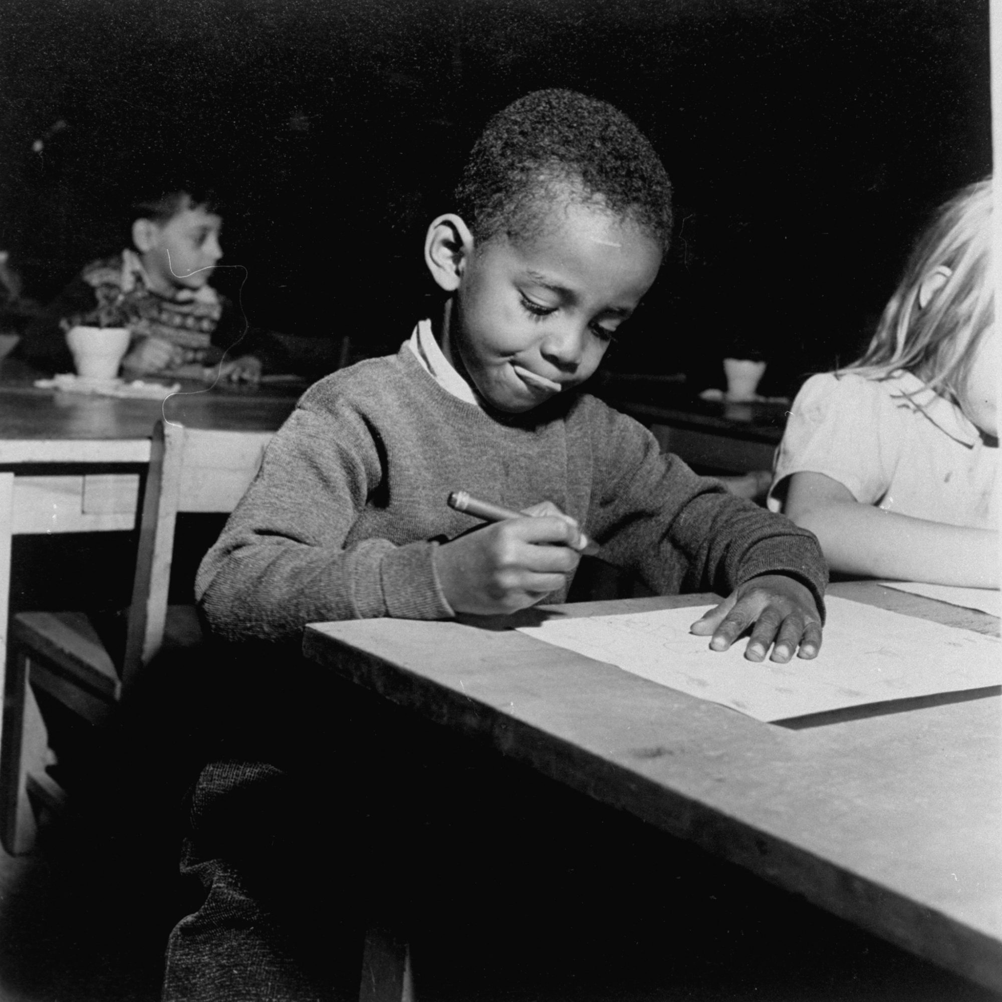 Little Boy Writing During Class