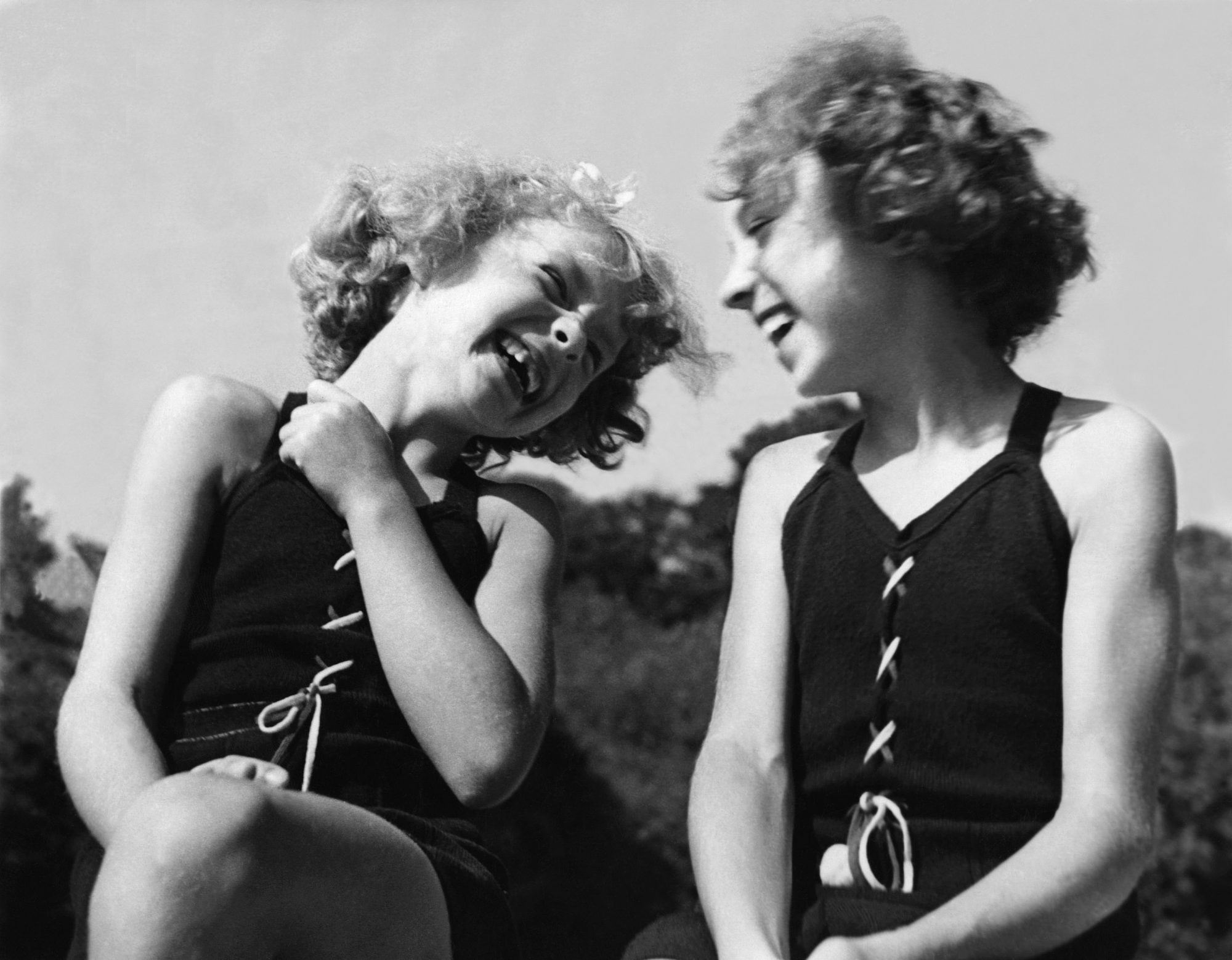 Two Young Sisters Laughing