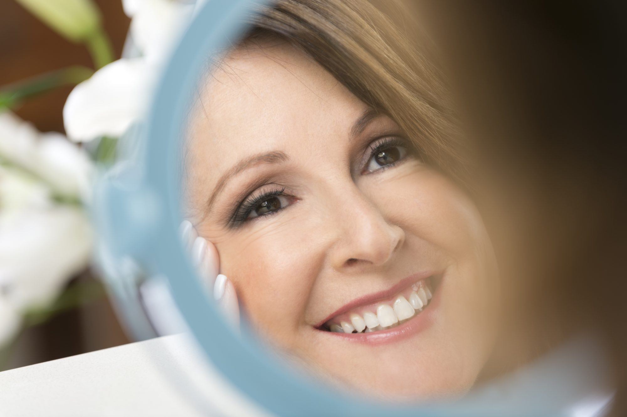 Woman Looking in Makeup Mirror