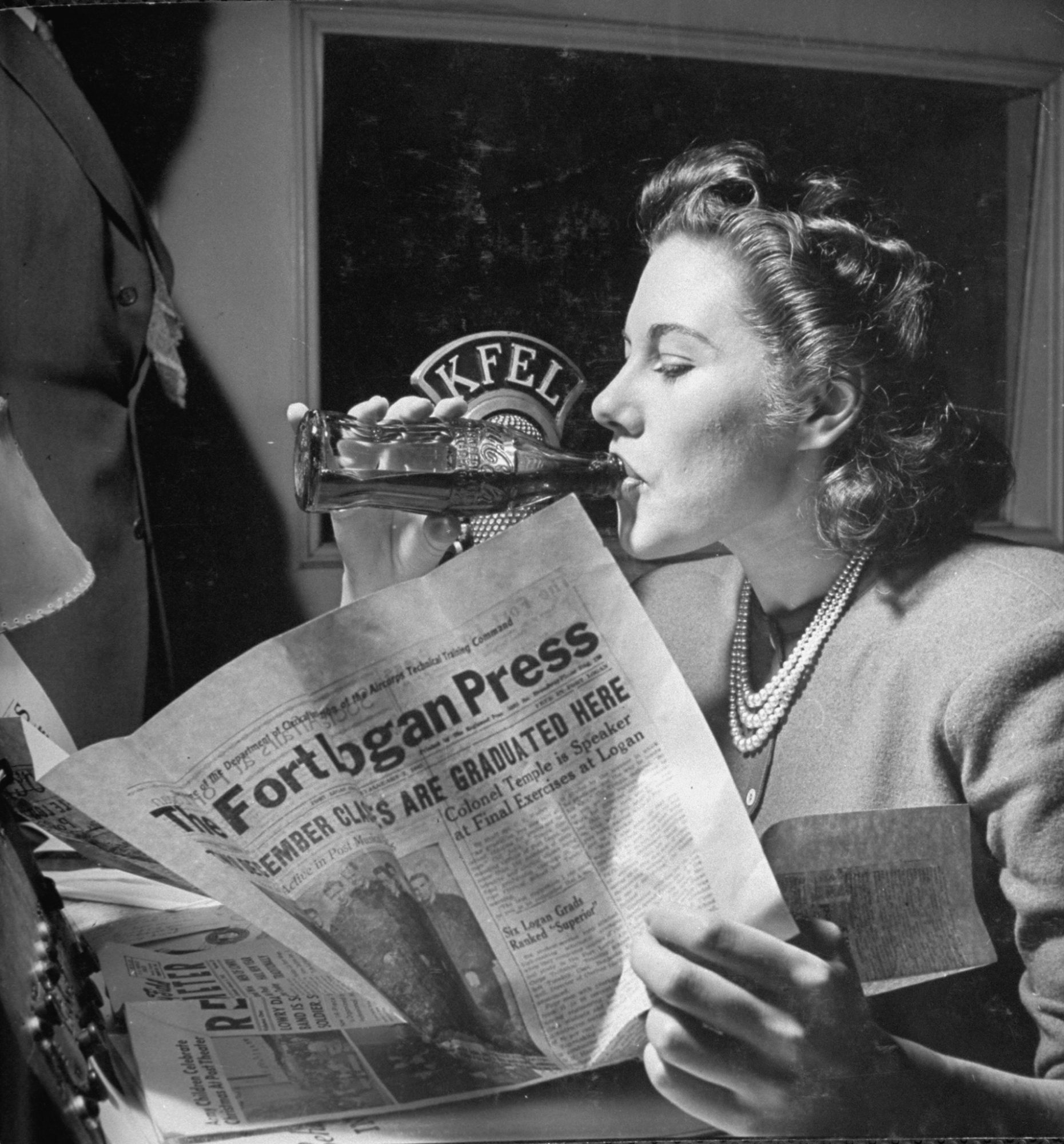 Woman Drinking from Glass Coke Bottle