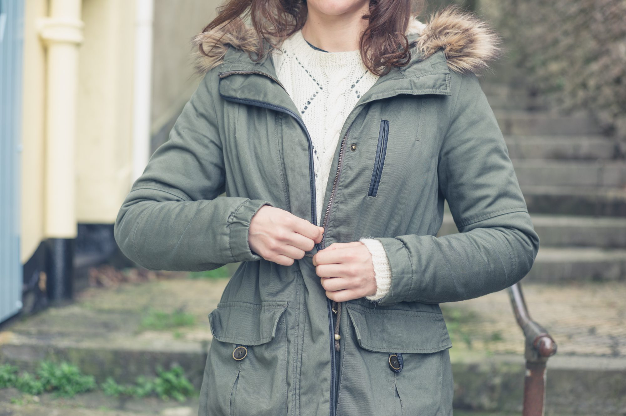 Woman Zipping Winter Coat