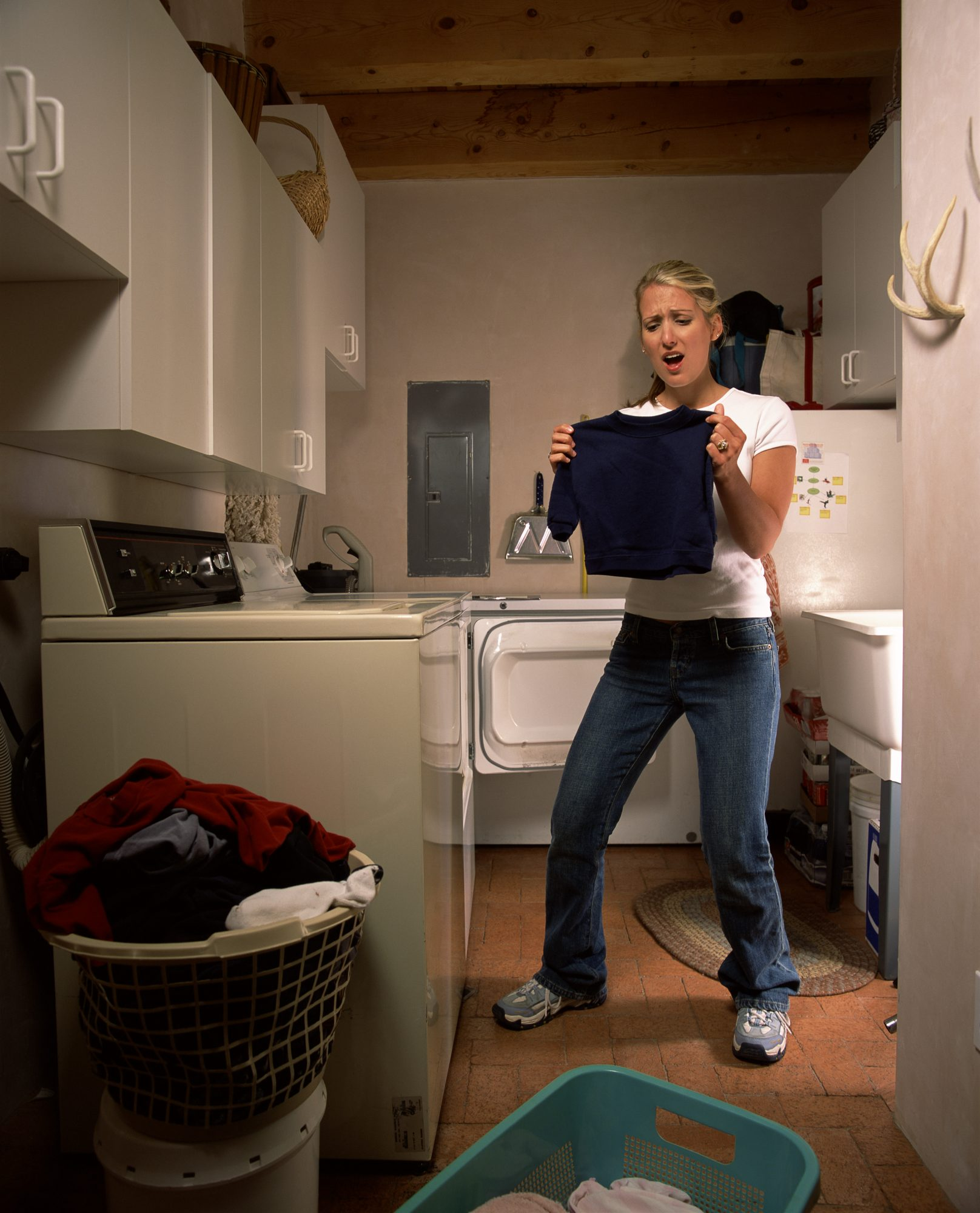 Woman Shrinks Sweater in Laundry