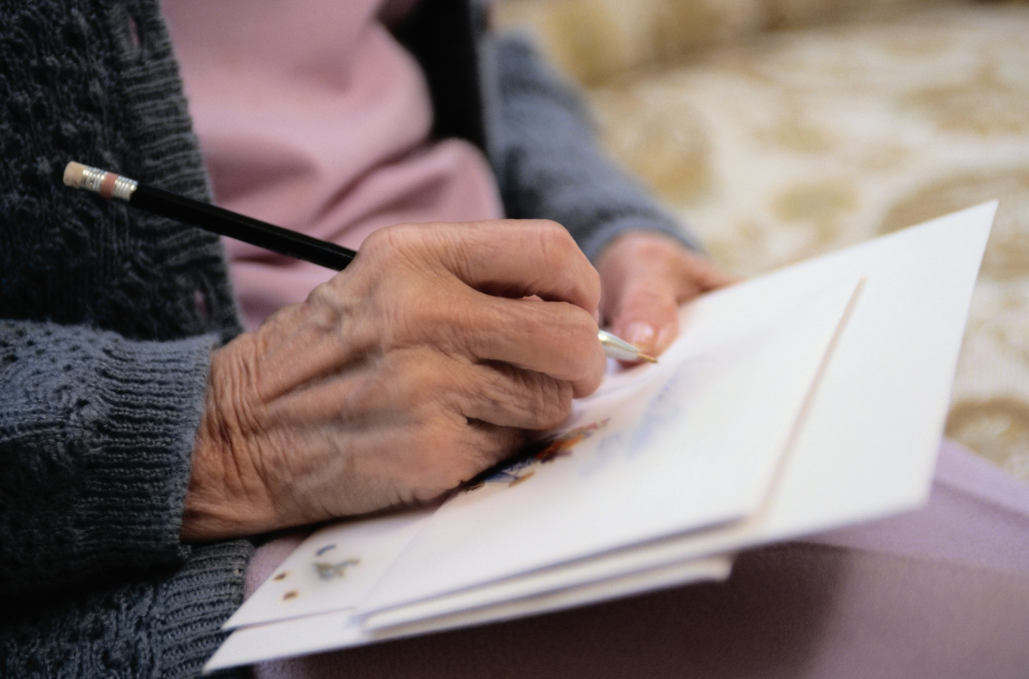 Older Woman Writing Letter