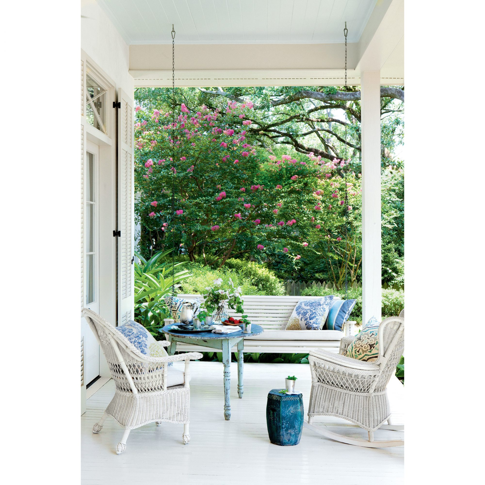 Blue and White Porch with Wicker Chairs and Swing