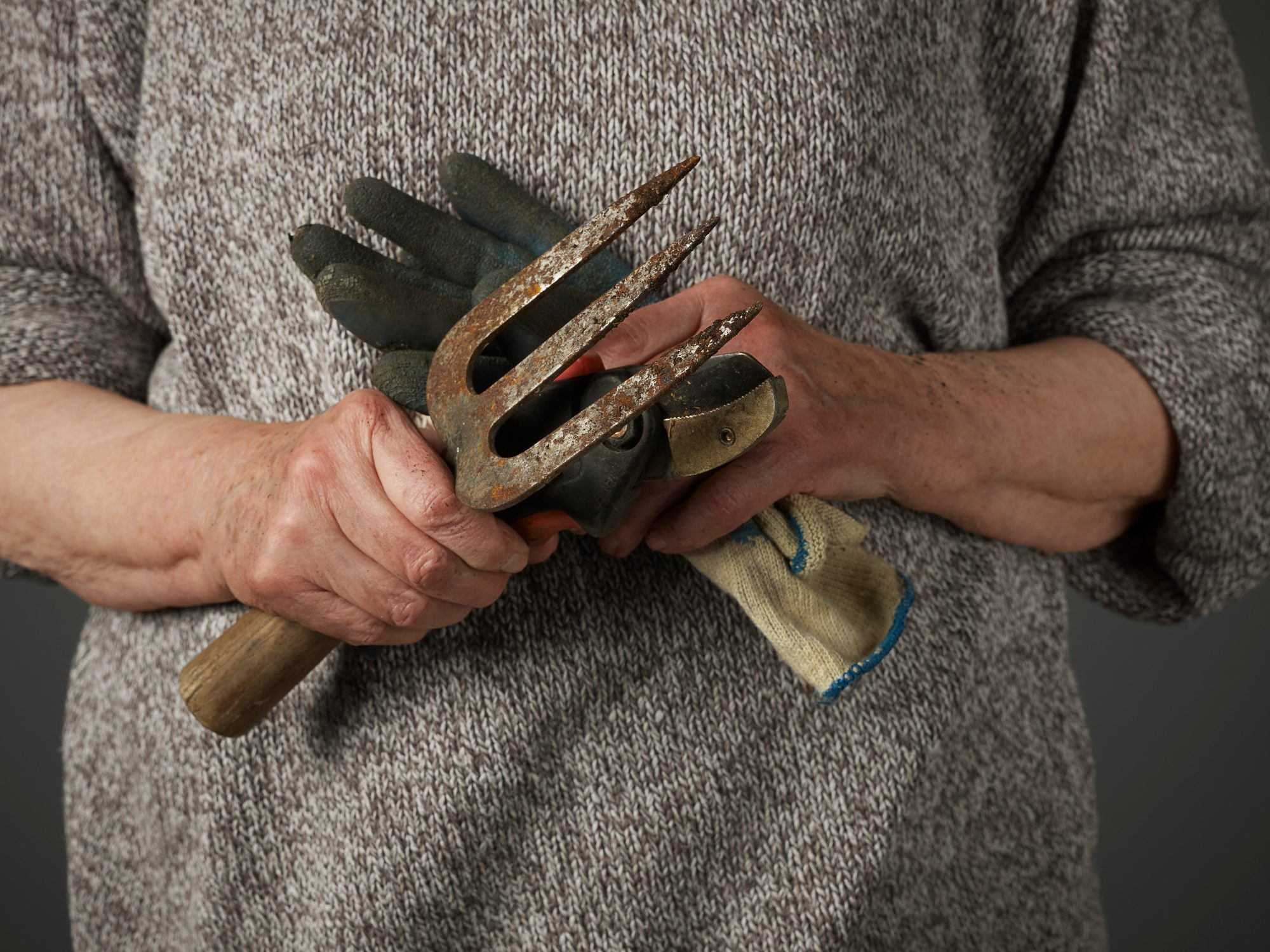 Woman Holding Gardening Gloves and Trowel