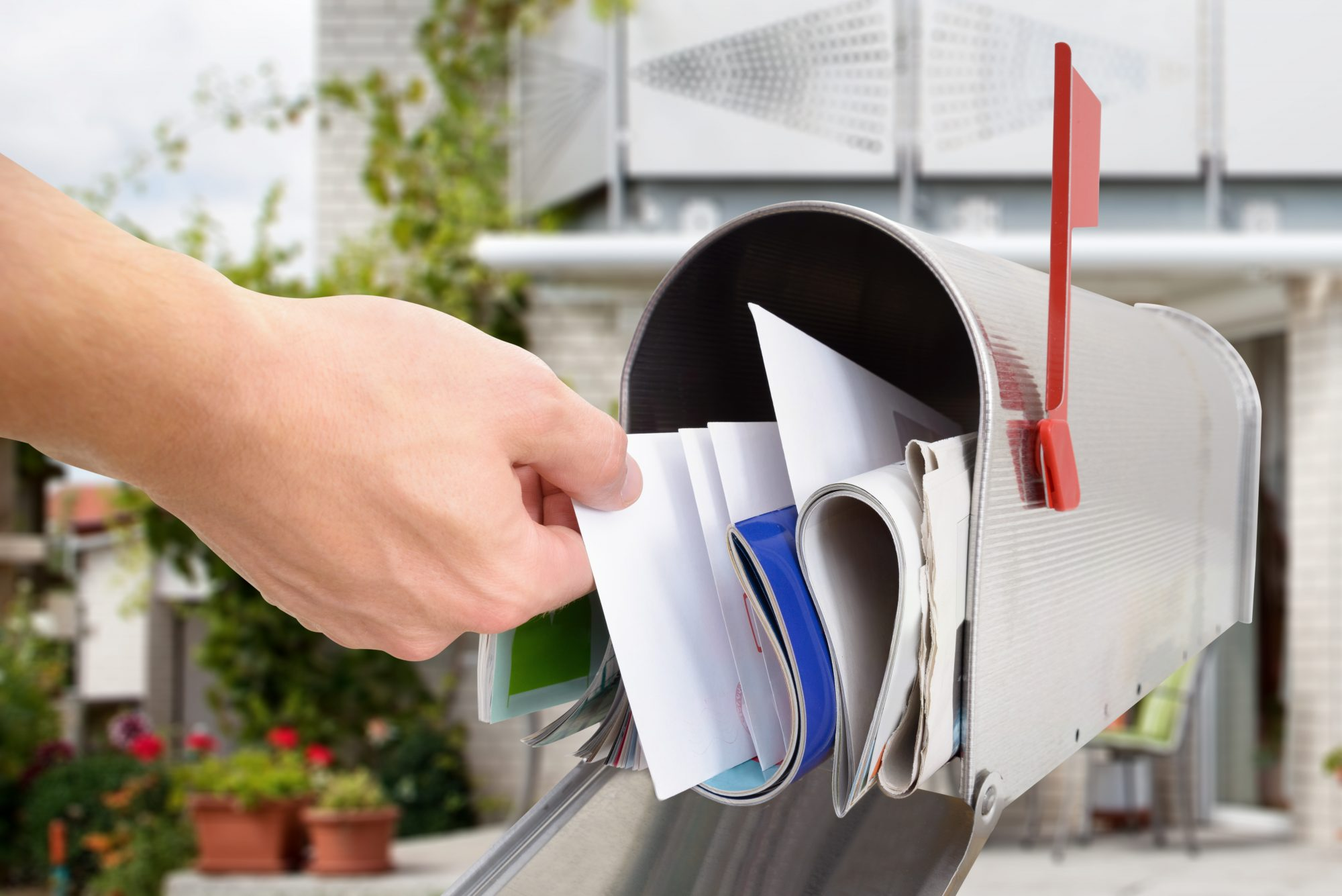 Hand Getting Mail from Mailbox