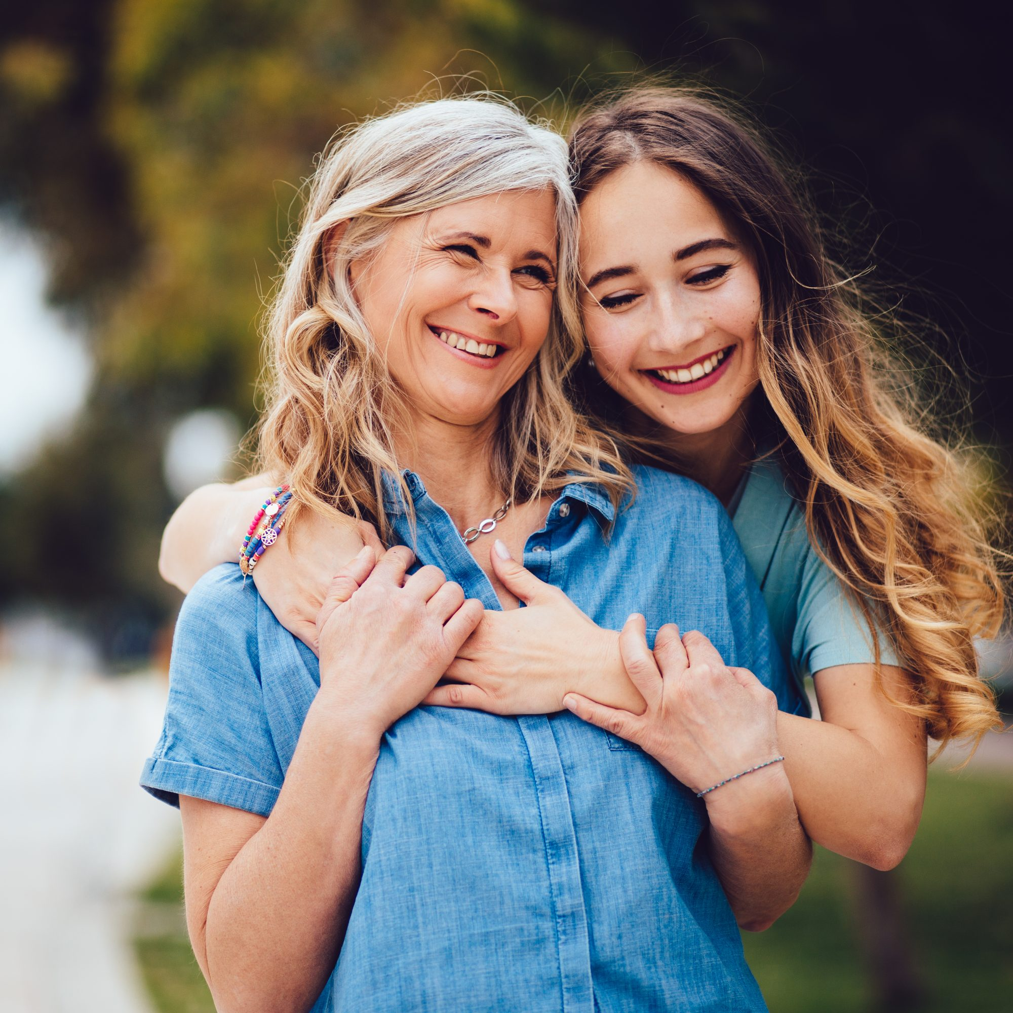 Adult Daughter Hugs Mom with Long Hair