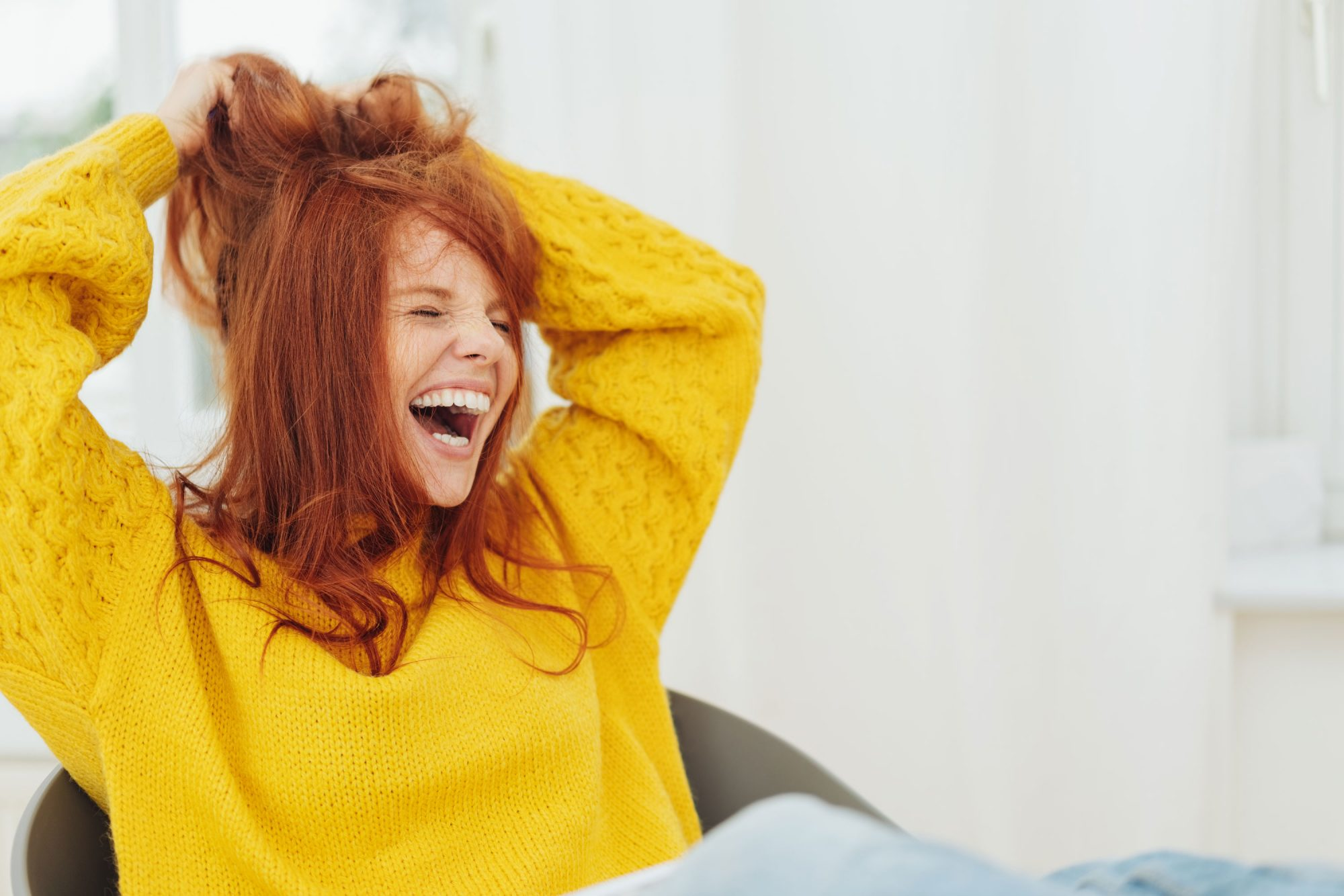 Woman with Red Hair Laughing
