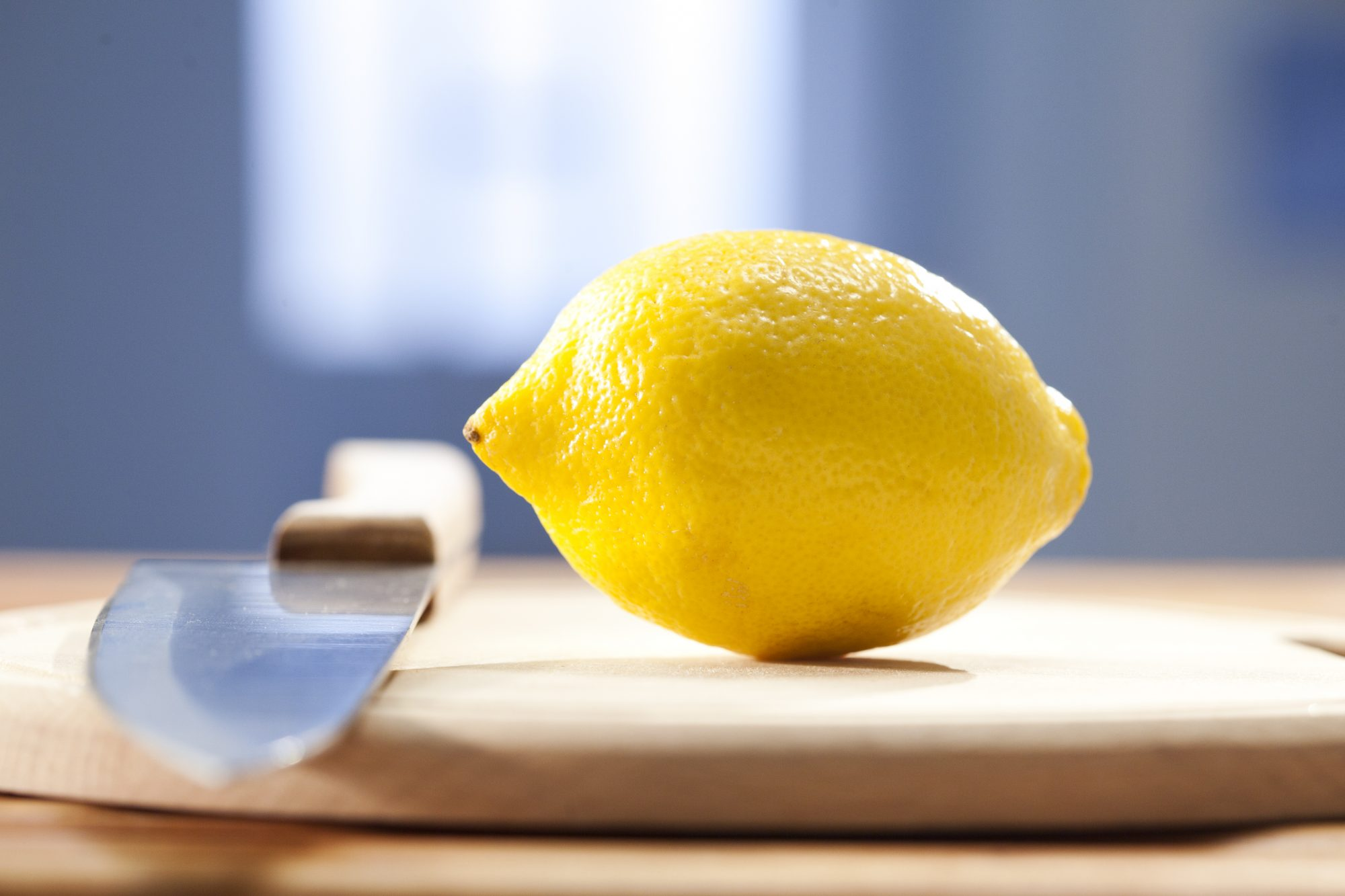 Lemon on Cutting Board