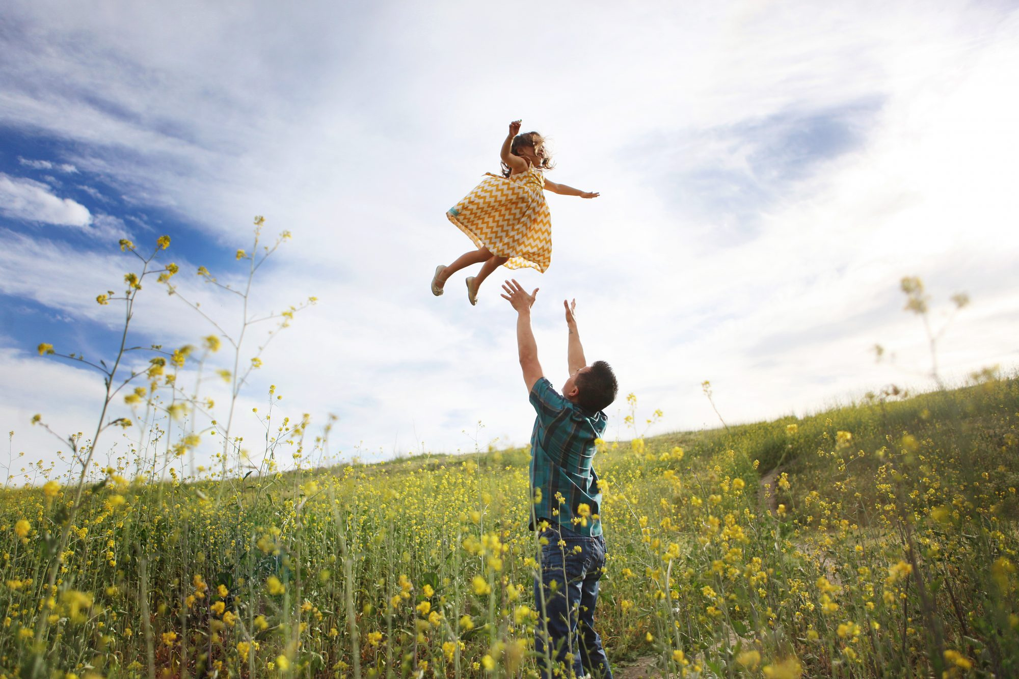 Dad and Daughter in a field