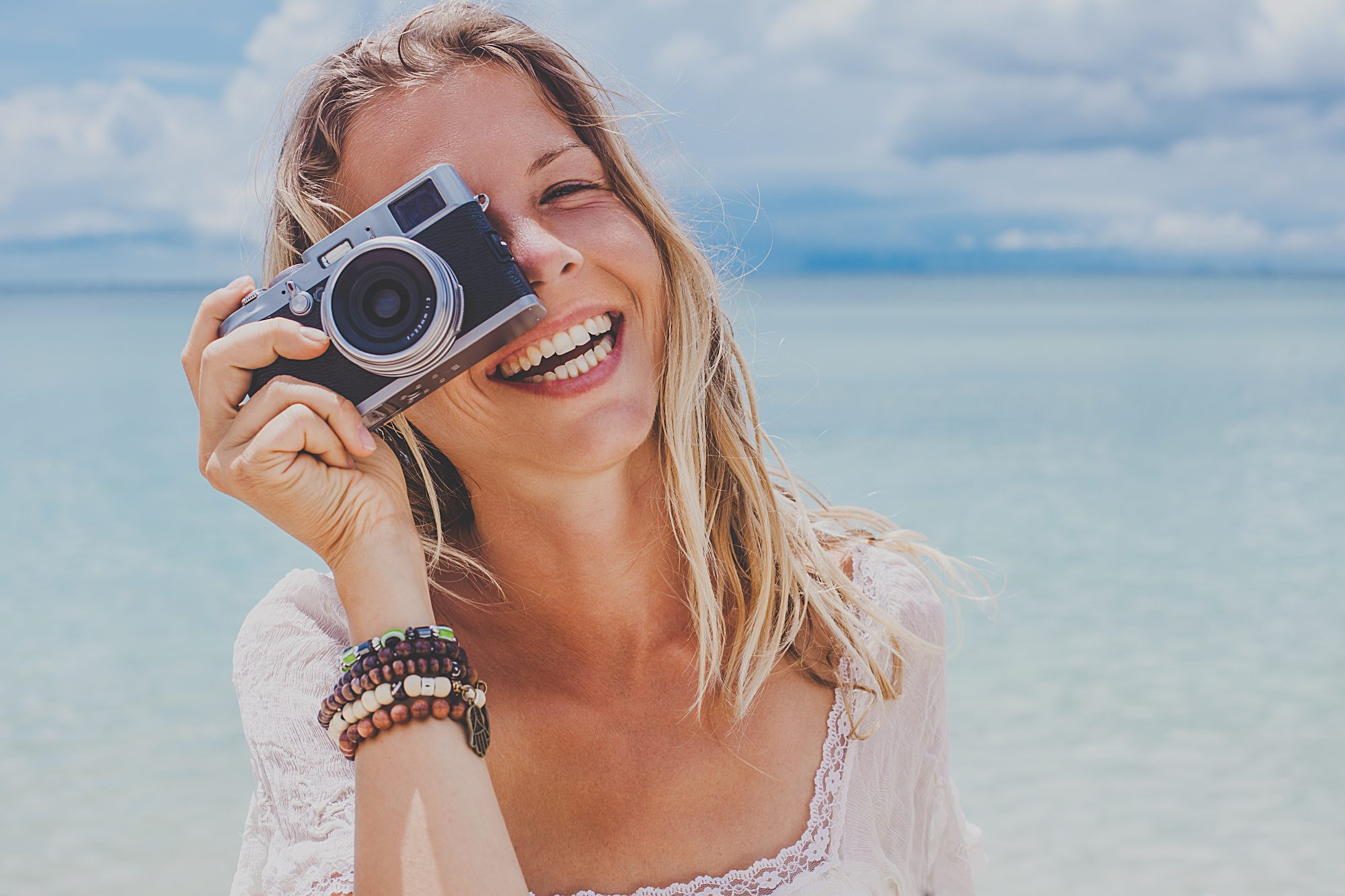 Girl a the Beach with Camera