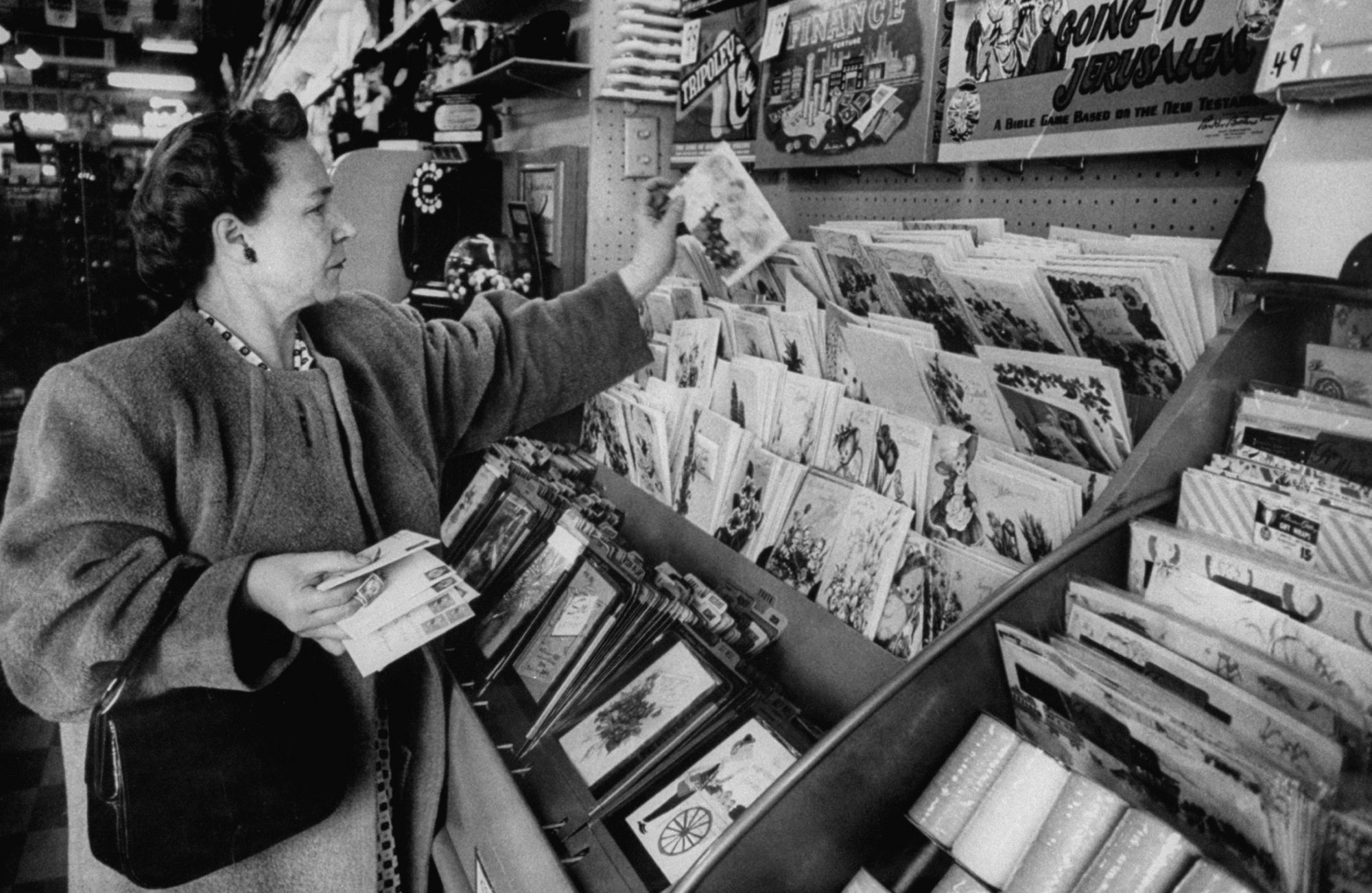 Woman Looking at Greeting Cards