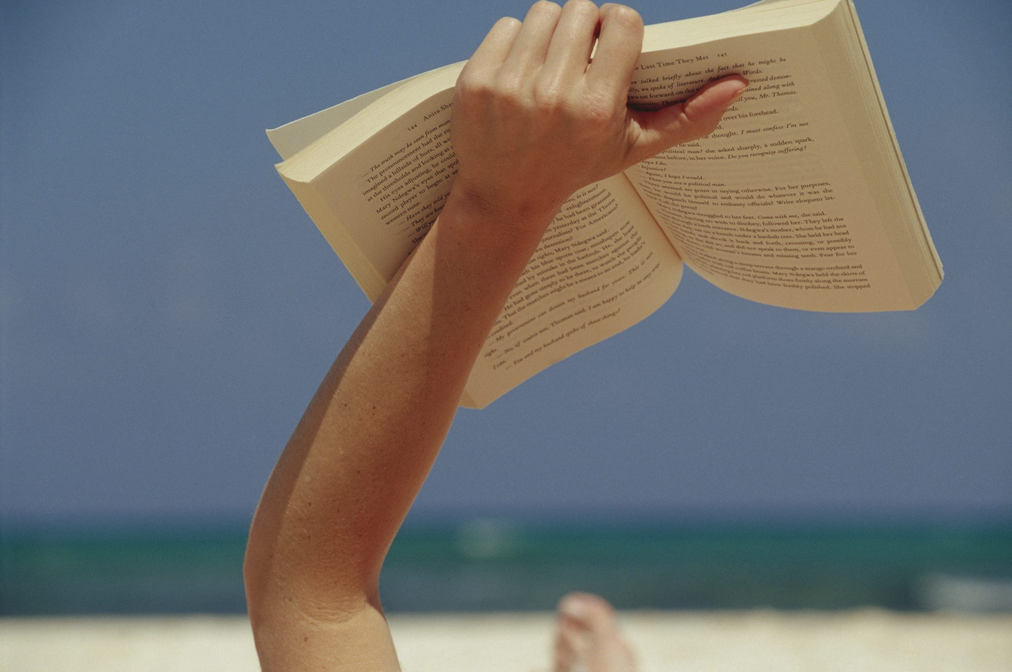 Person Reading on Beach