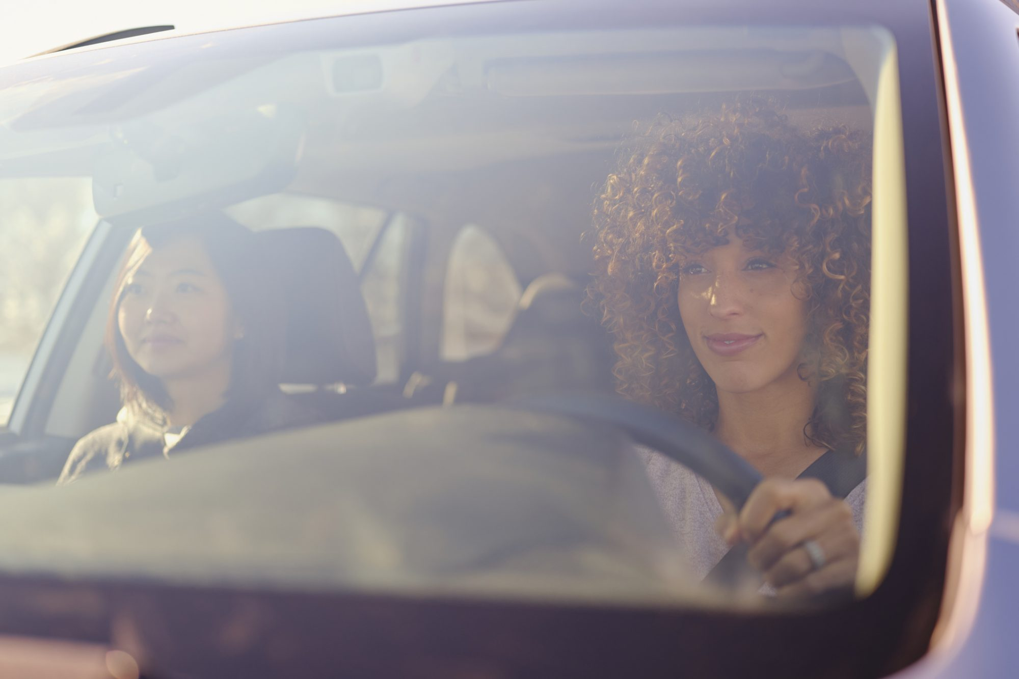 Two Women Riding in Car for Road Trip