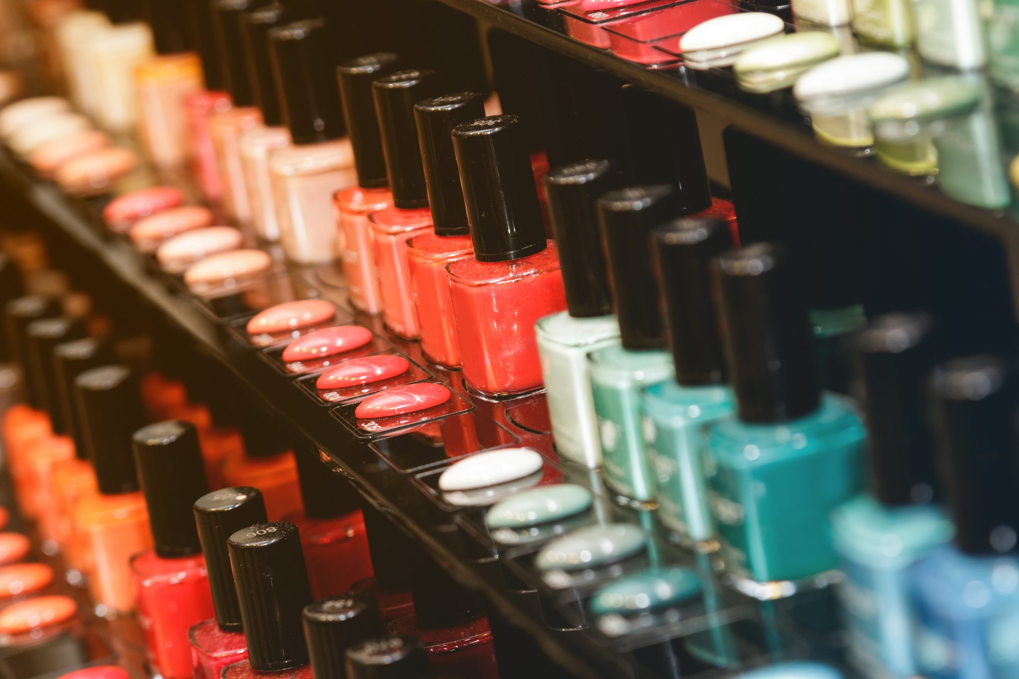 This is Summer's Biggest Nail Polish Trend_Getty Nail Polish Bottles