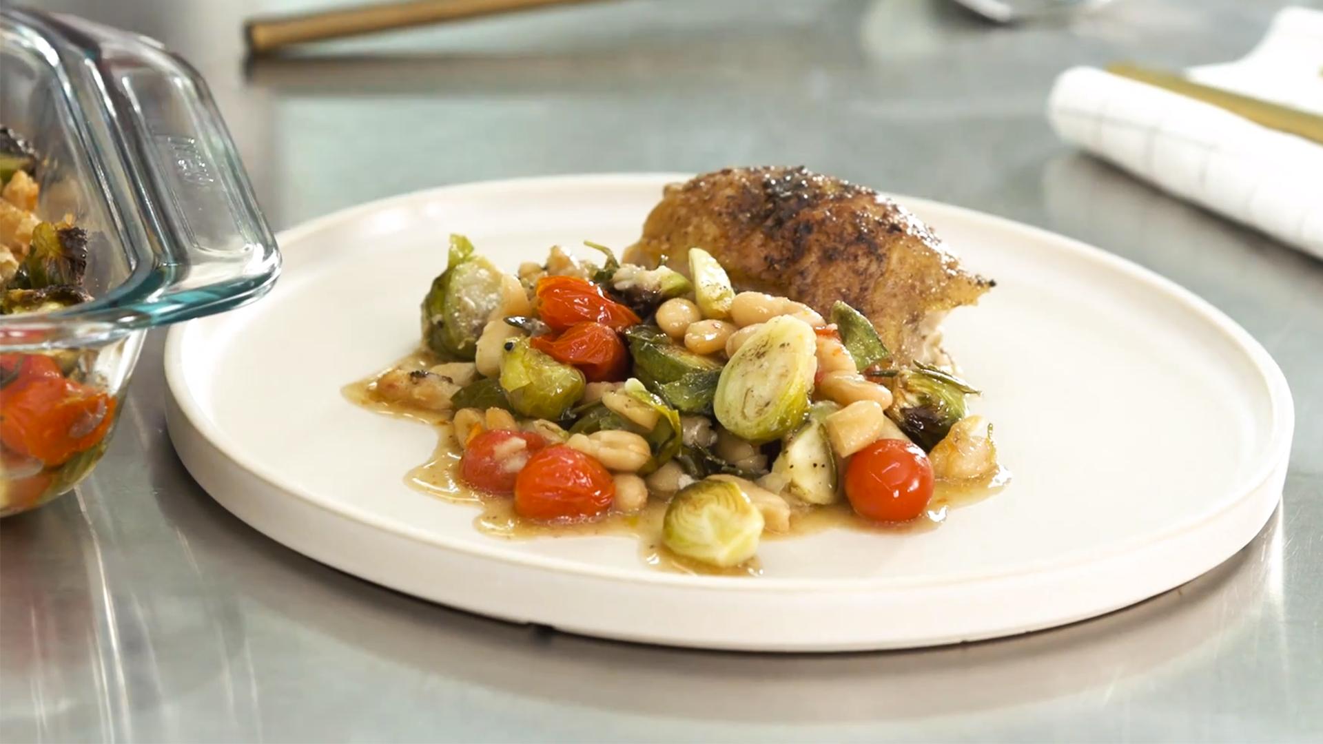 Crispy Baked Chicken Thighs with Brussels and Beans