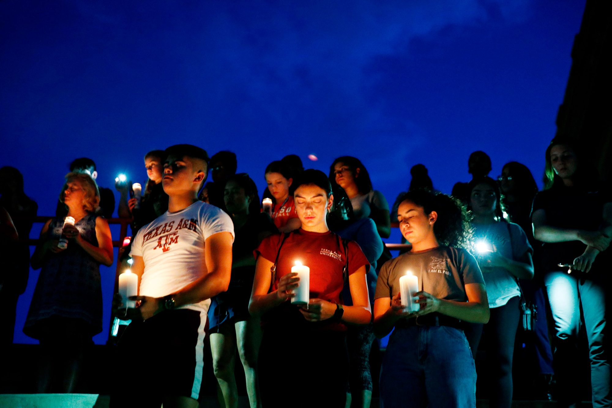 From left, Samuel Lerma, Arzetta Hodges and Desiree Quintanar attend a vigil for victims of the deadly shooting that occurred earlier in the day at a shopping center, in El Paso, Texas Texas Mall Shooting, El Paso, USA