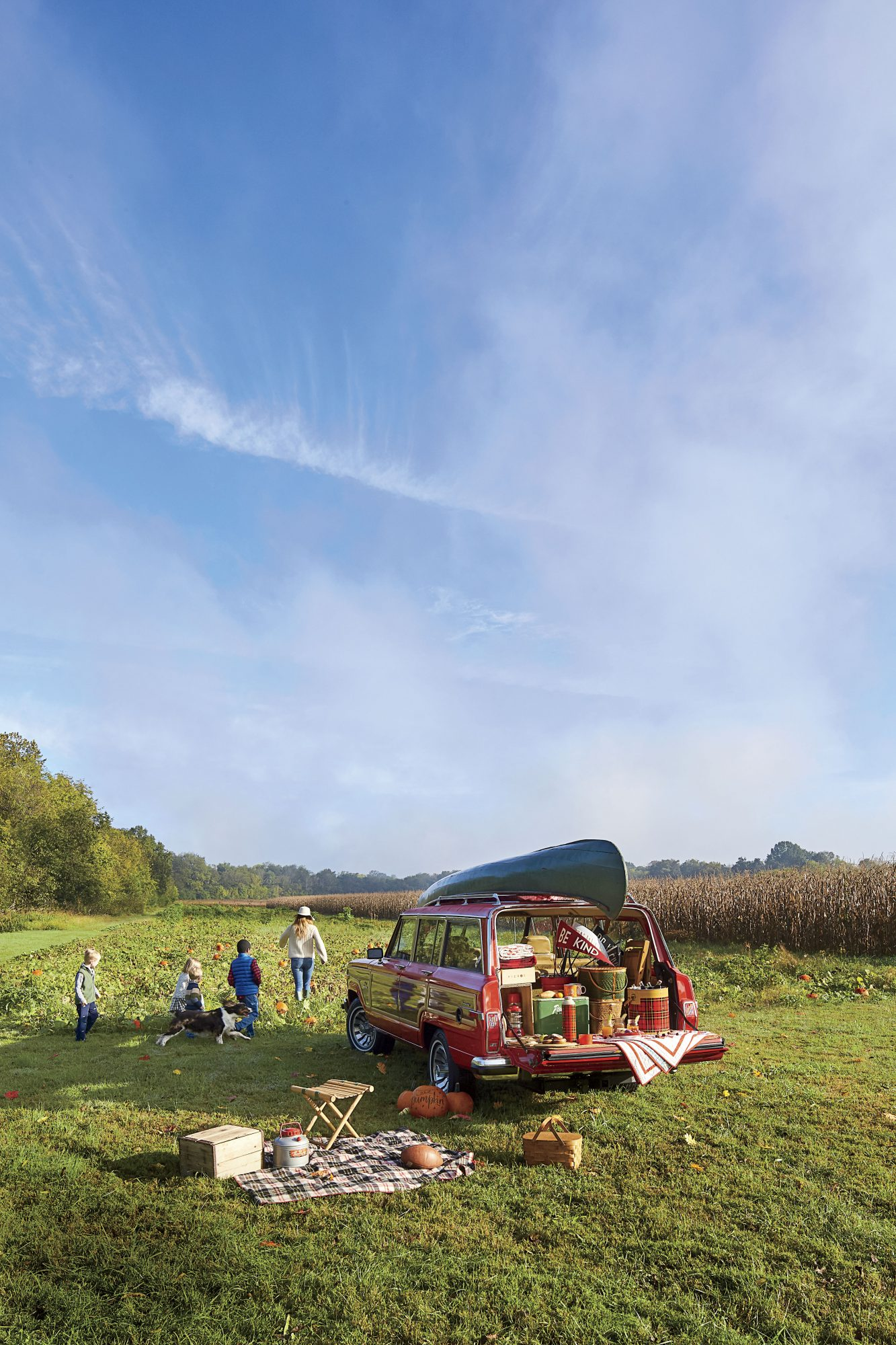 Katie Jacobs Fall Tailgate at Pumpkin Patch with Kids and Dog Running into Patch