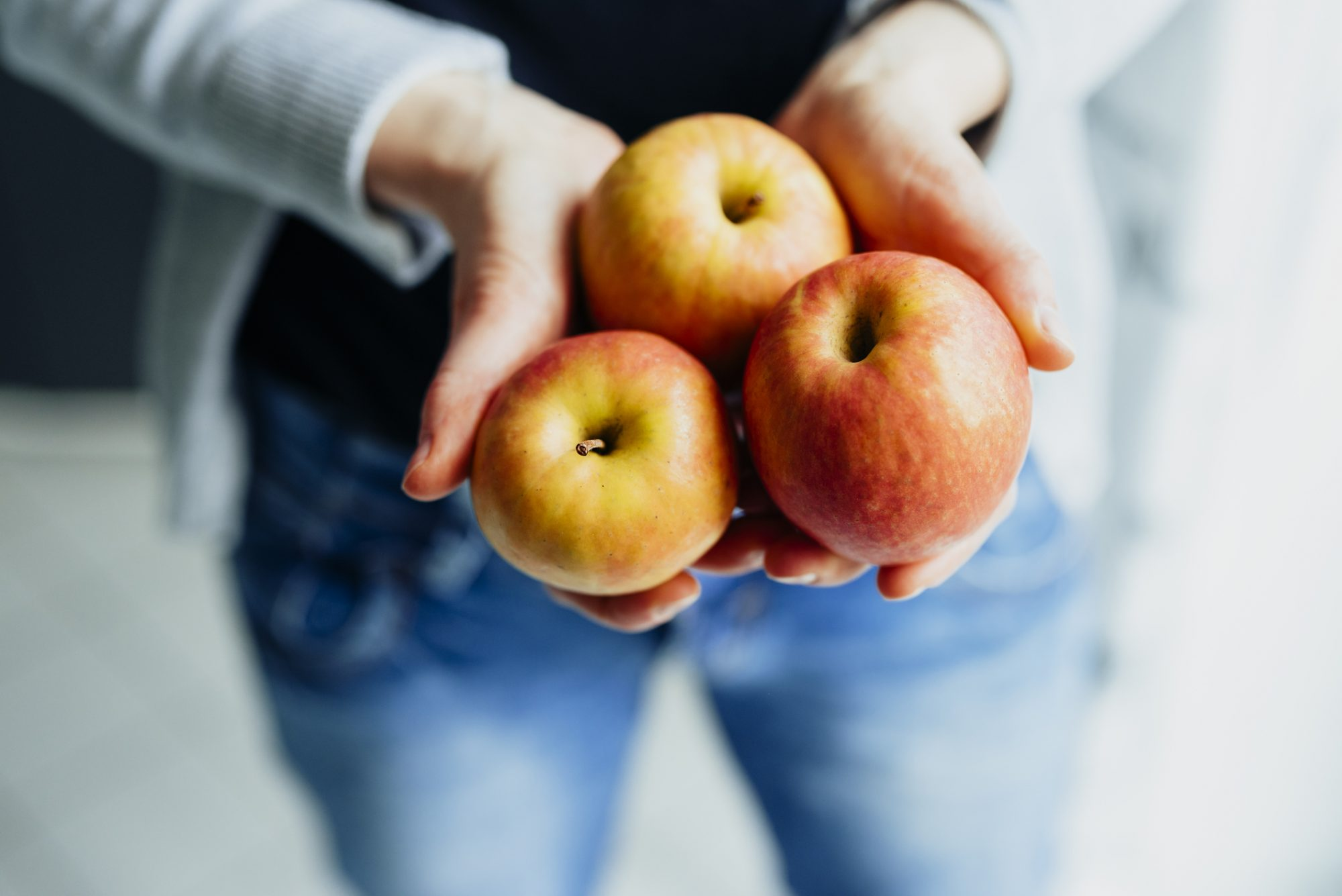 Hand Holding Apples