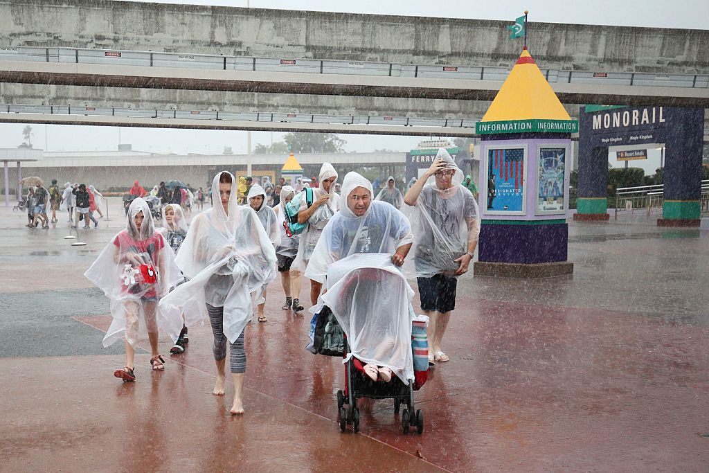 People Leaving Disney World in the Rain