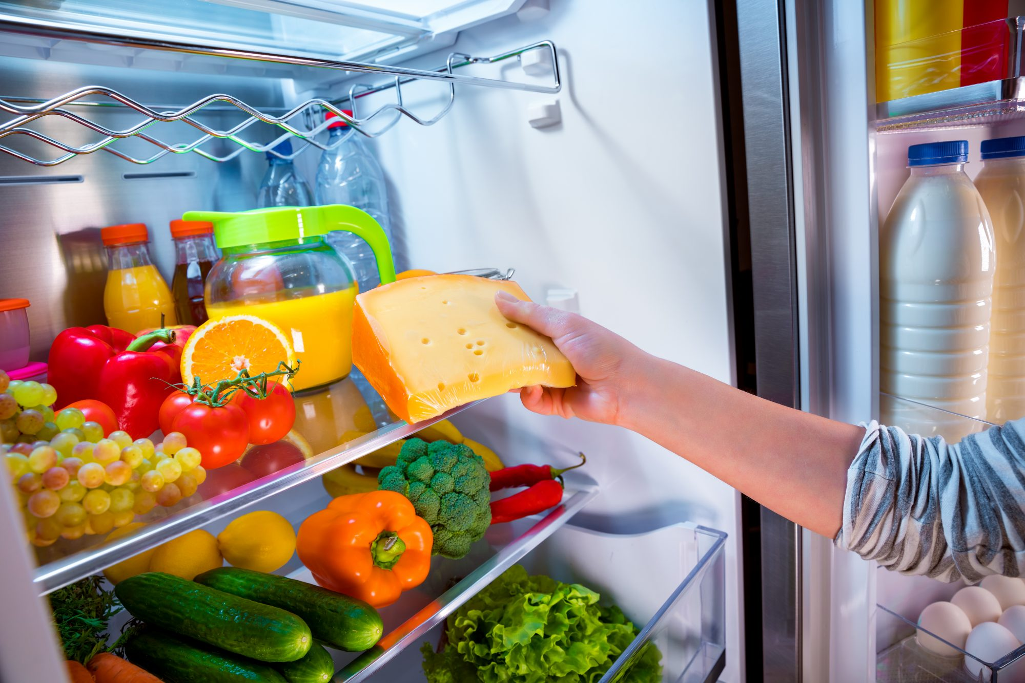 Inside Refrigerator with Produce and Cheese