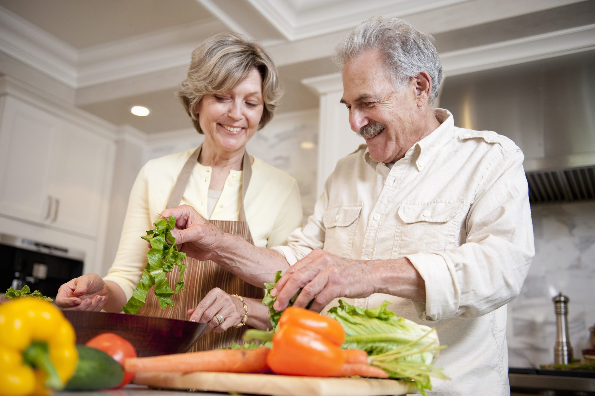 Couple Preparing Salad in Kitchen