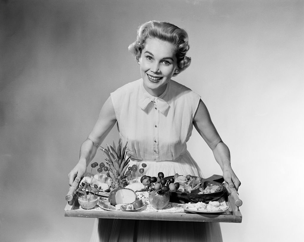 1950s Hostess Serving Appetizers