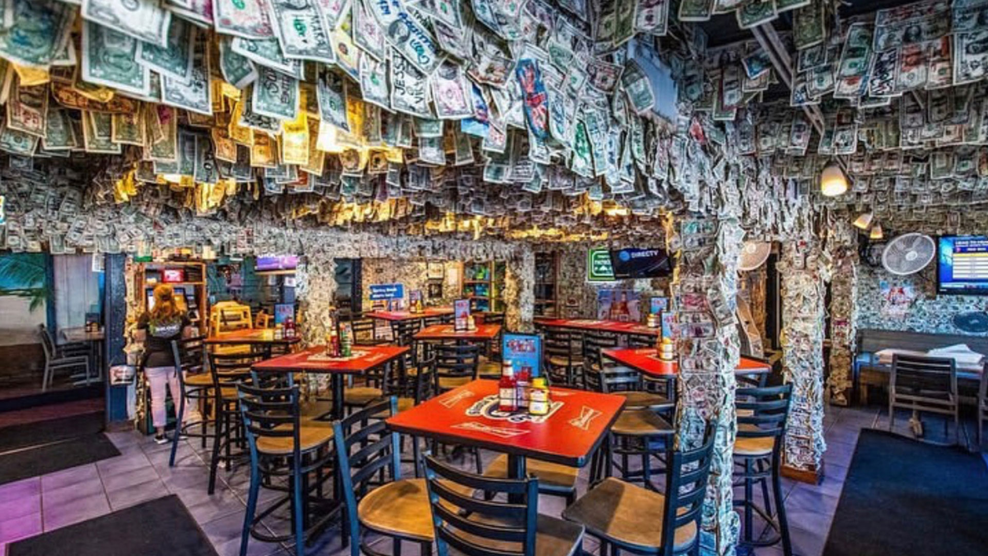 Florida Bar Removes Famous Dollar Bill Decor, Collects $15,000 for Hurricane Dorian Relief