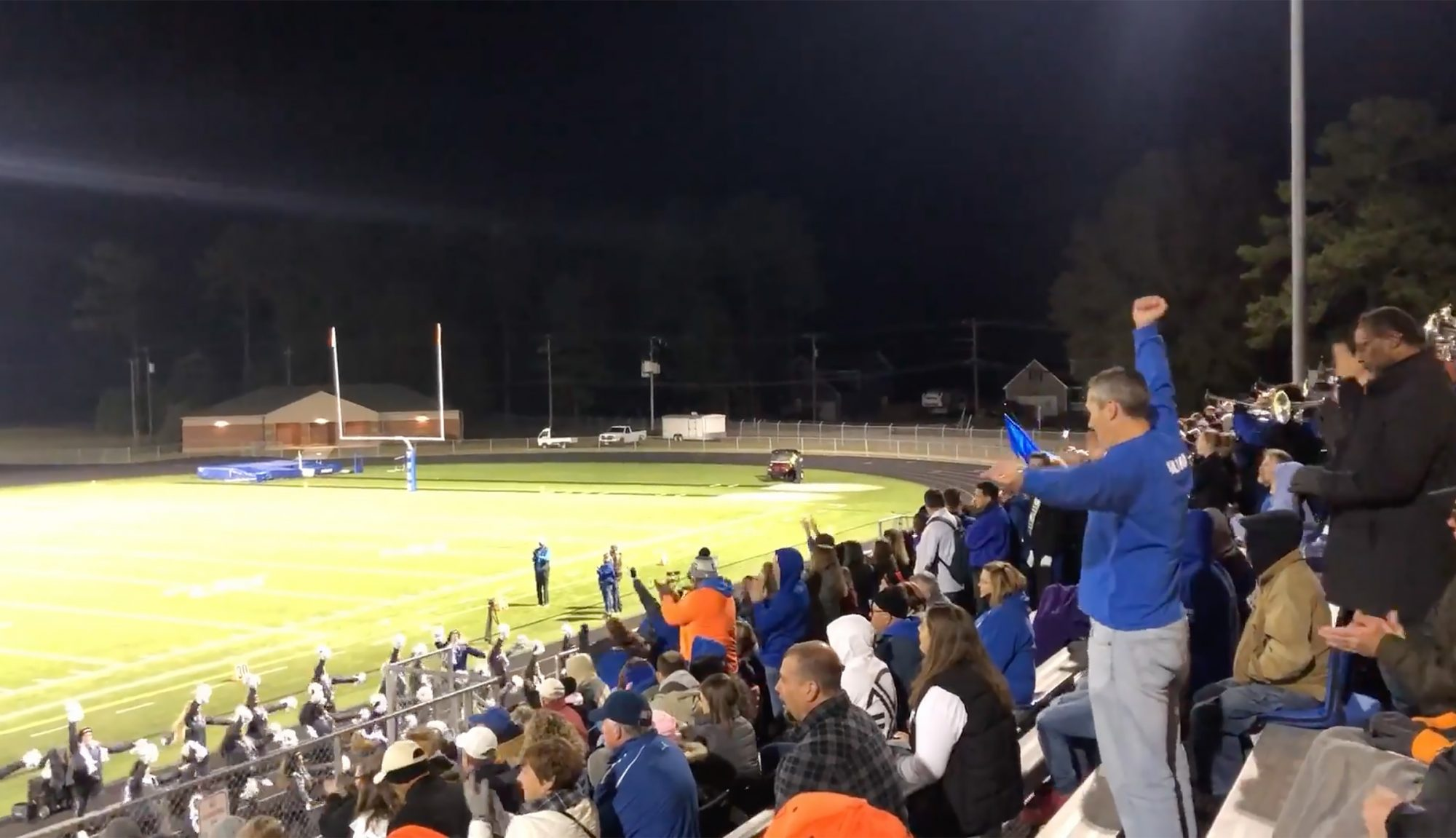 """Rolland """"Hekili"""" Holland goes to as many York High School football games as he can to support his daughter, a cheerleader for the squad in Yorktown, Va."""