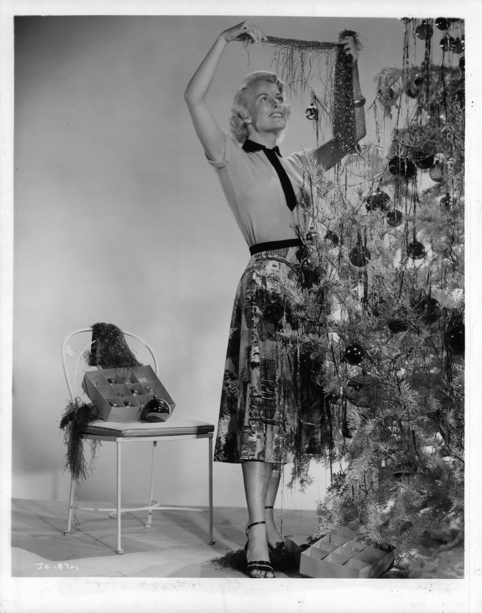 Christmas woman decorating tree