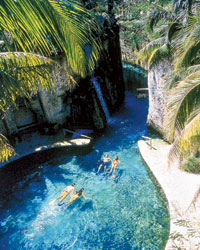 Courtesy of Occidental Hotels & Resorts Swimmers in Xcaret Park, in Quintana Roo, Mexico.