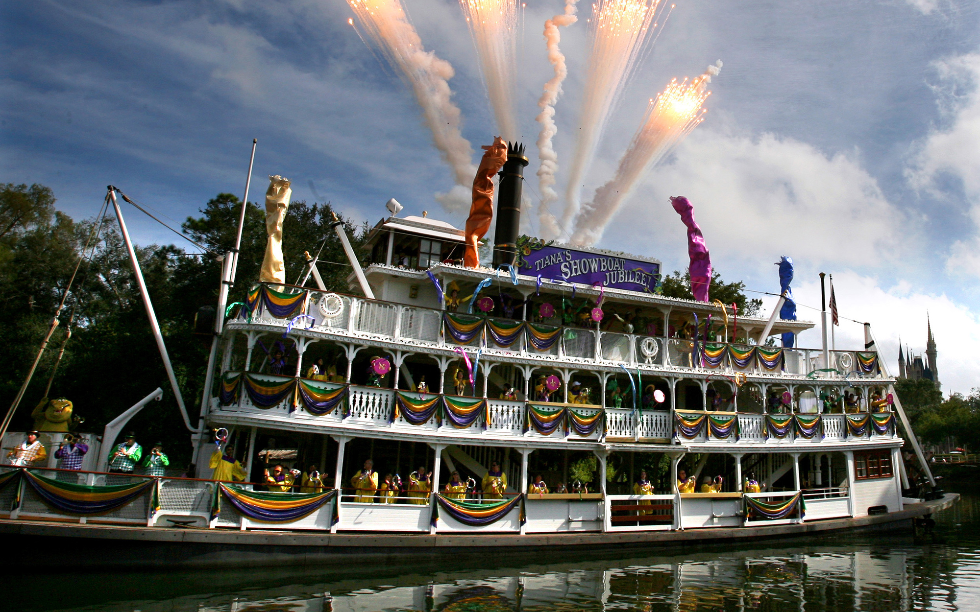 "Fireworks blast off the top of the Liberty Belle Riverboat as Princess Tiana performs with dancers and a jazz band in the new ""Tiana's Showboat Jubilee"" during her debut day in the Magic Kingdom, at Walt Disney World, Monday, October 26, 20"