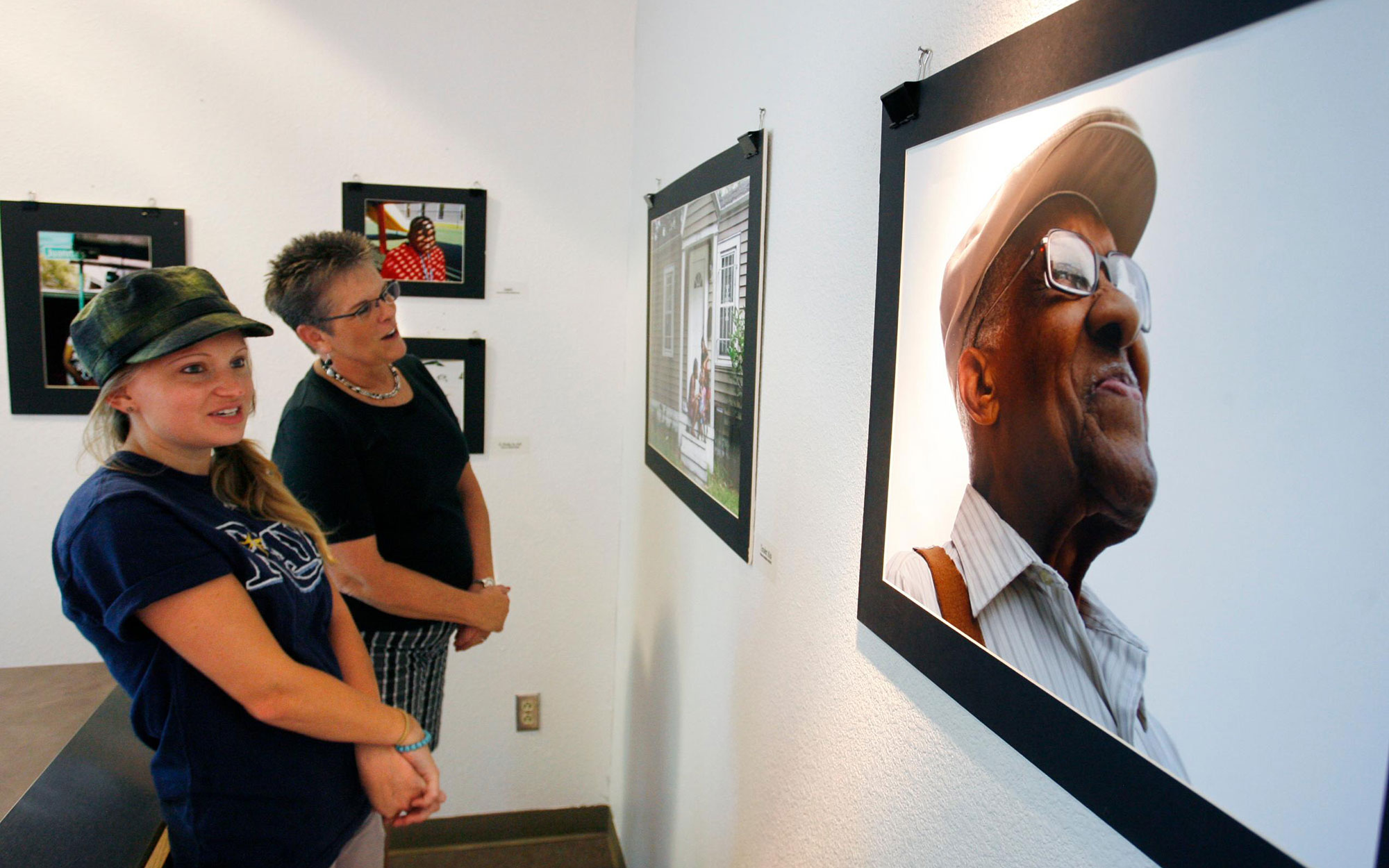 DC41N5 Aug. 8, 2013 - St. Petersburg, Florida, U.S. - SCOTT KEELER    |    Times. 2. Left to Right: Brenda Barker, a 4th grade teacher and Kim Lopez, a 5th grade teacher, both from Melrose Elementary School, view student photographs at the Carter Woodson