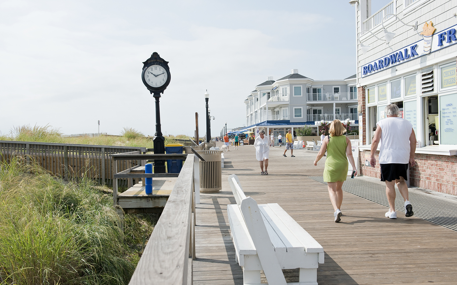 Bethany Beach, Delaware, USA, August 21, 2014: Beach visitors enjoying walks on the boardwalk in late August