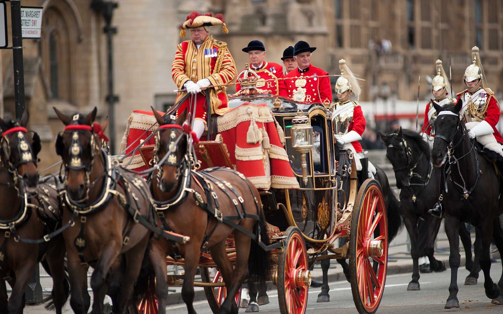 Ornate coach and mounted escort