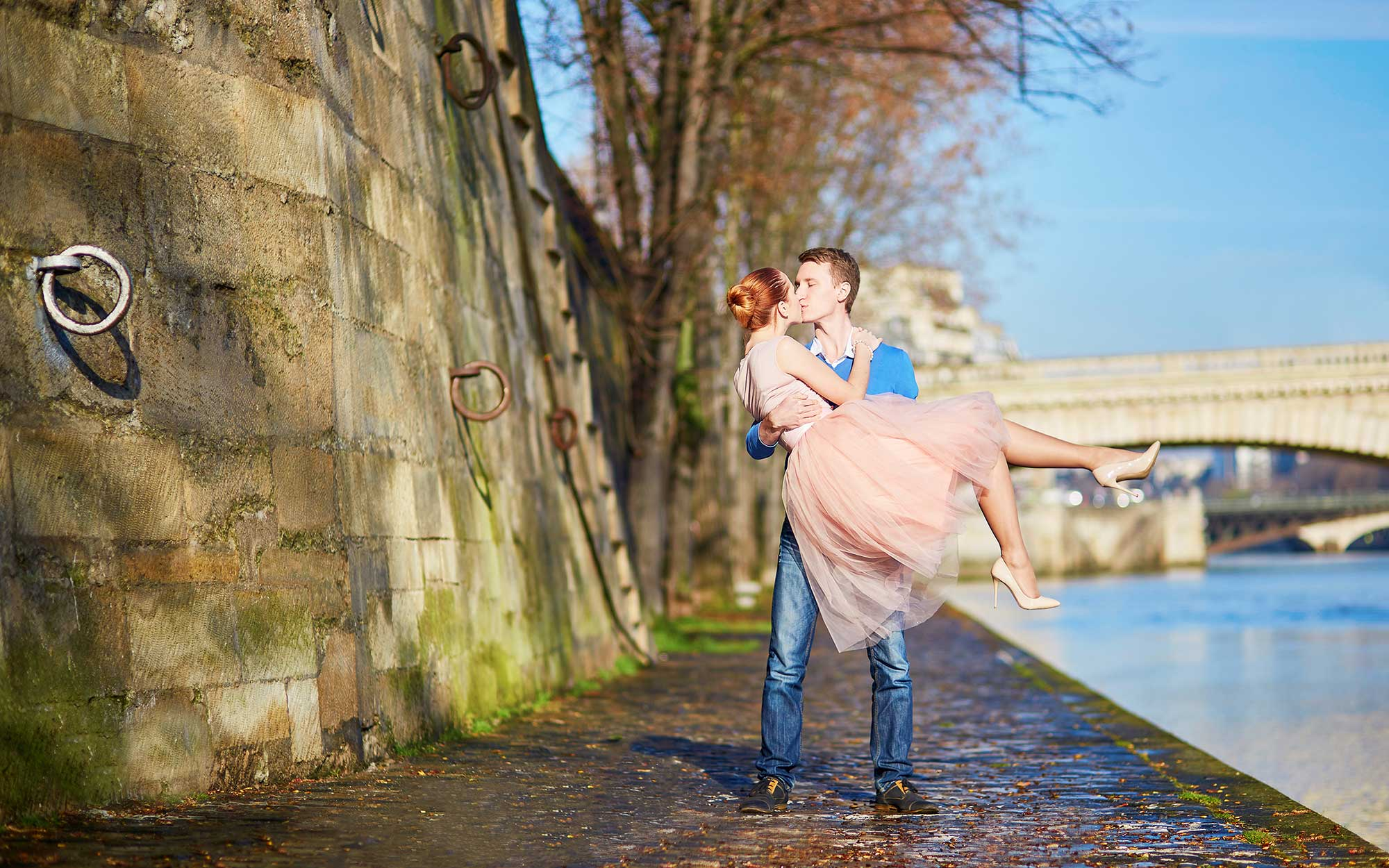 Beautiful romantic couple in Paris near the river Seine