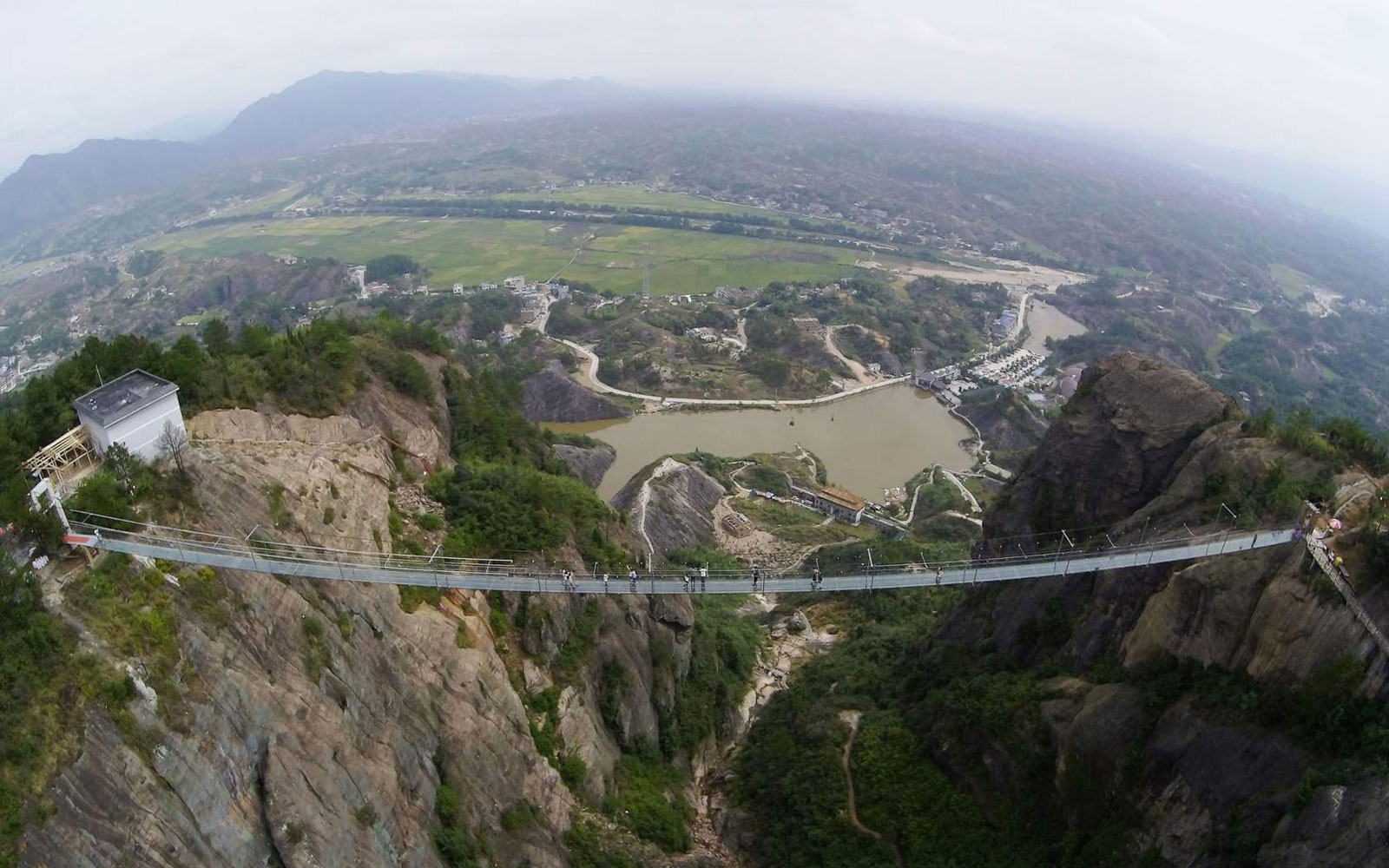 China's Longest Glass Bridge Undergoes a Sledgehammer Test: Watch the Video