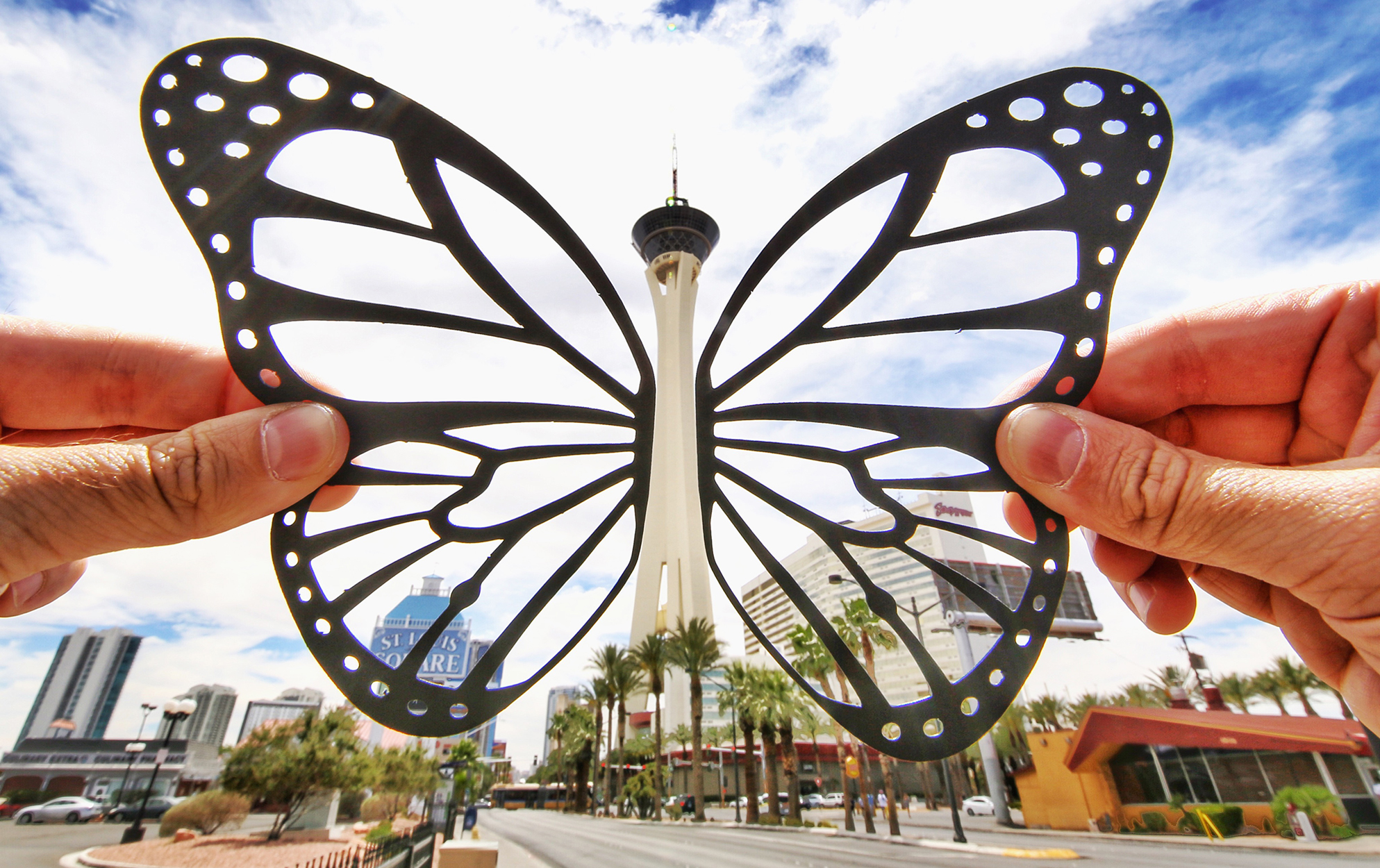 Photographer transforms famous landmarks with paper cutouts