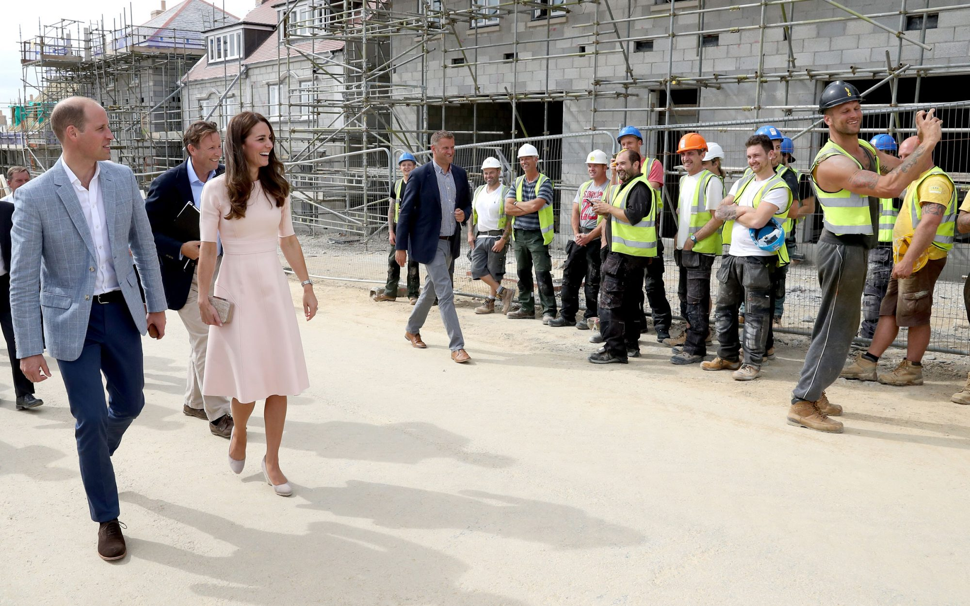 Construction Worker Caught Taking a Selfie with Kate Middleton and Prince William
