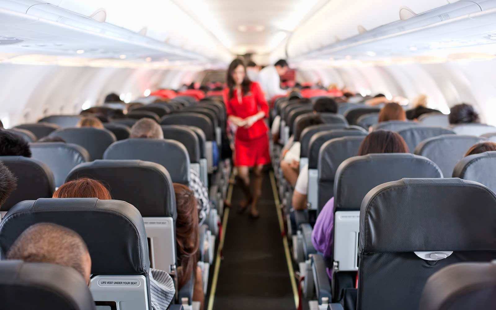 How to Survive a Plane Crash, According to a Former Flight Attendant