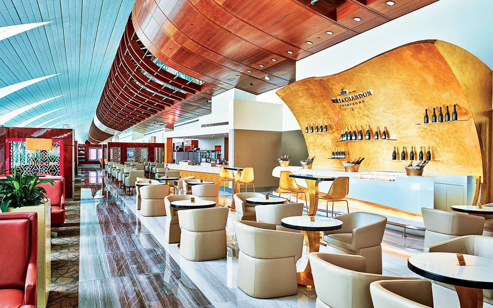 Emirates coach passengers in business/first class lounges