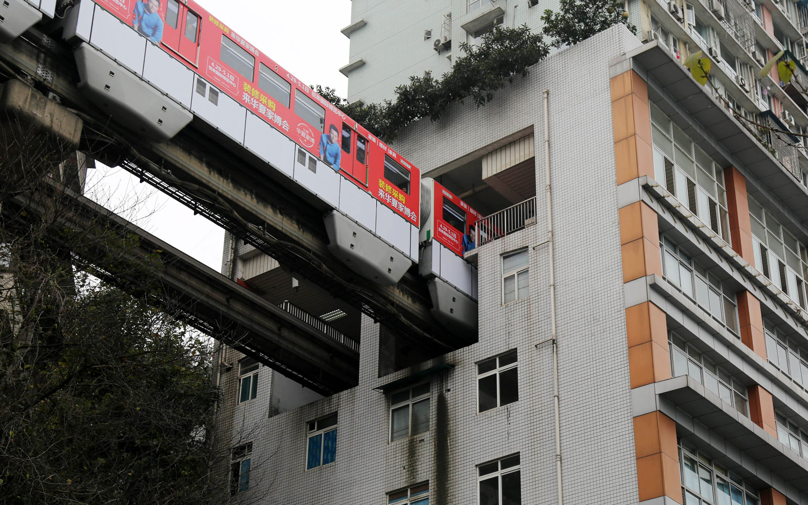 There's a Train in China That Passes Directly Through an Apartment Building