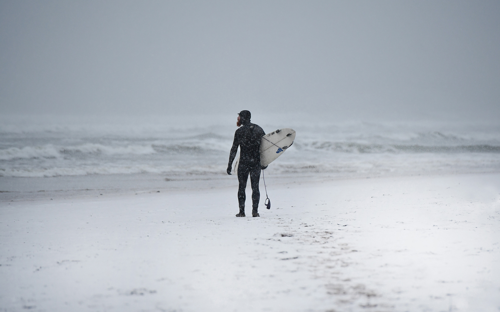 Surfer Hits the Waves in Storm Stella Blizzard