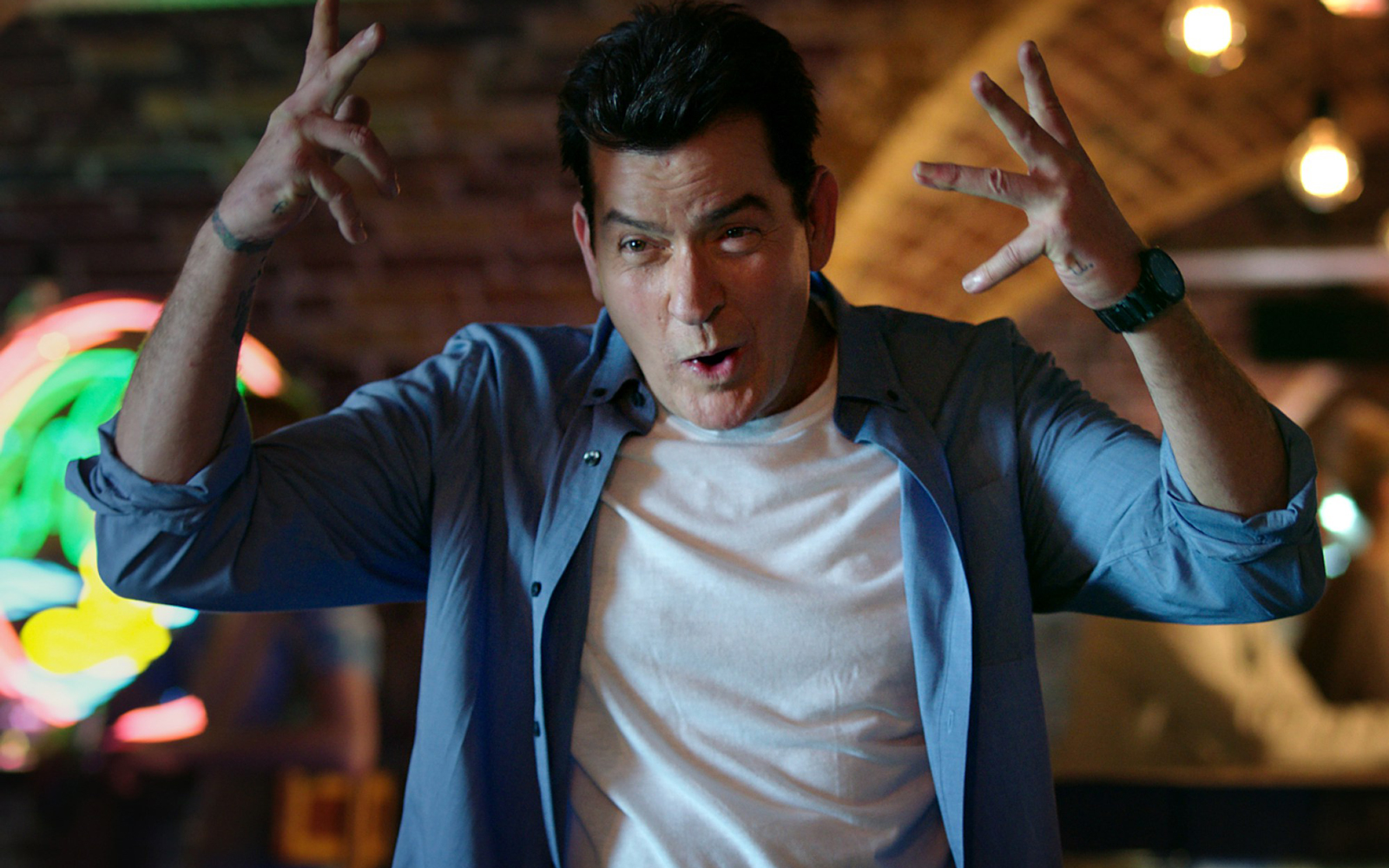 Charlie Sheen Wants You to Book a Hostel for Your Next Vacation