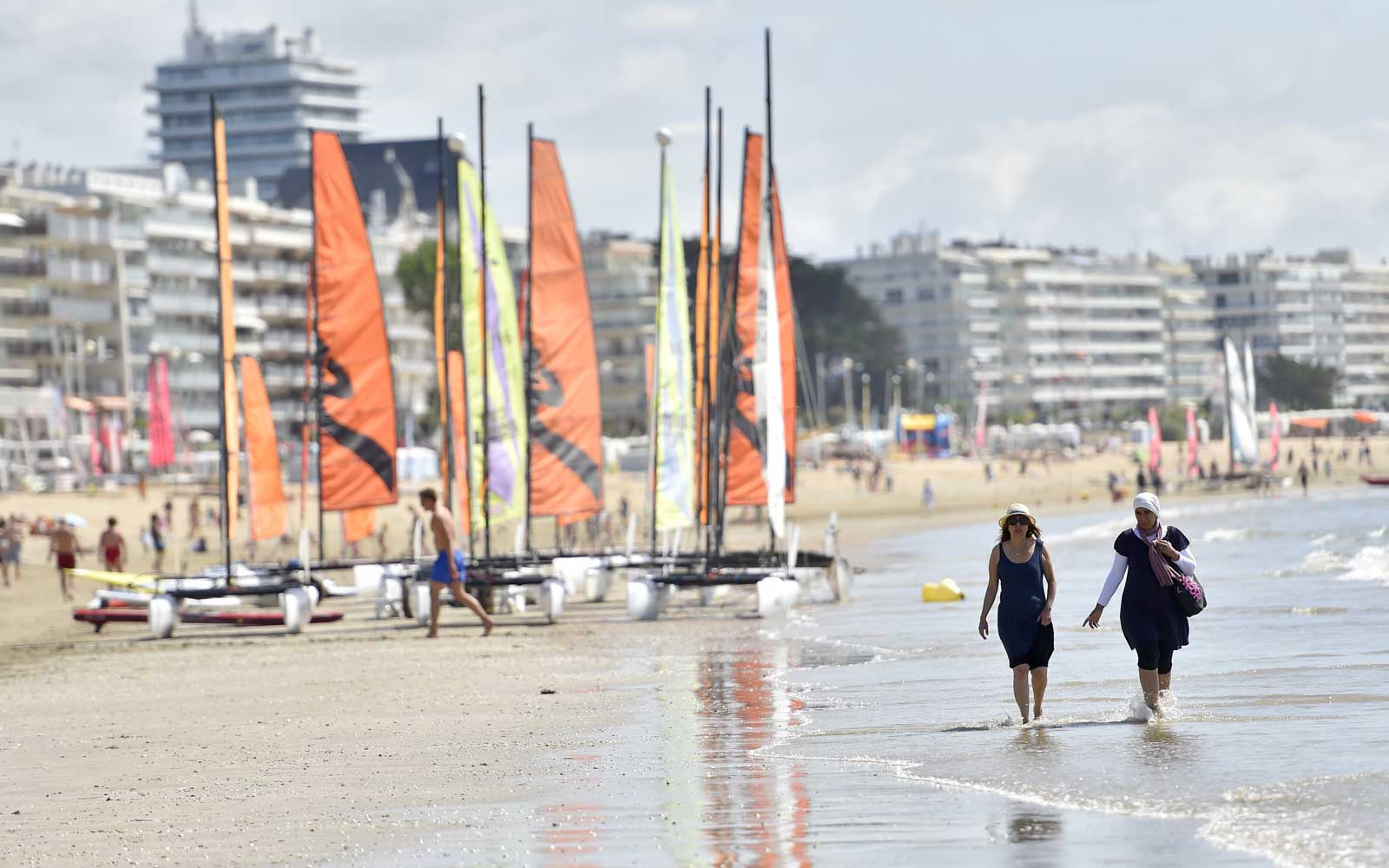 People enjoy time at the beach in La Baule