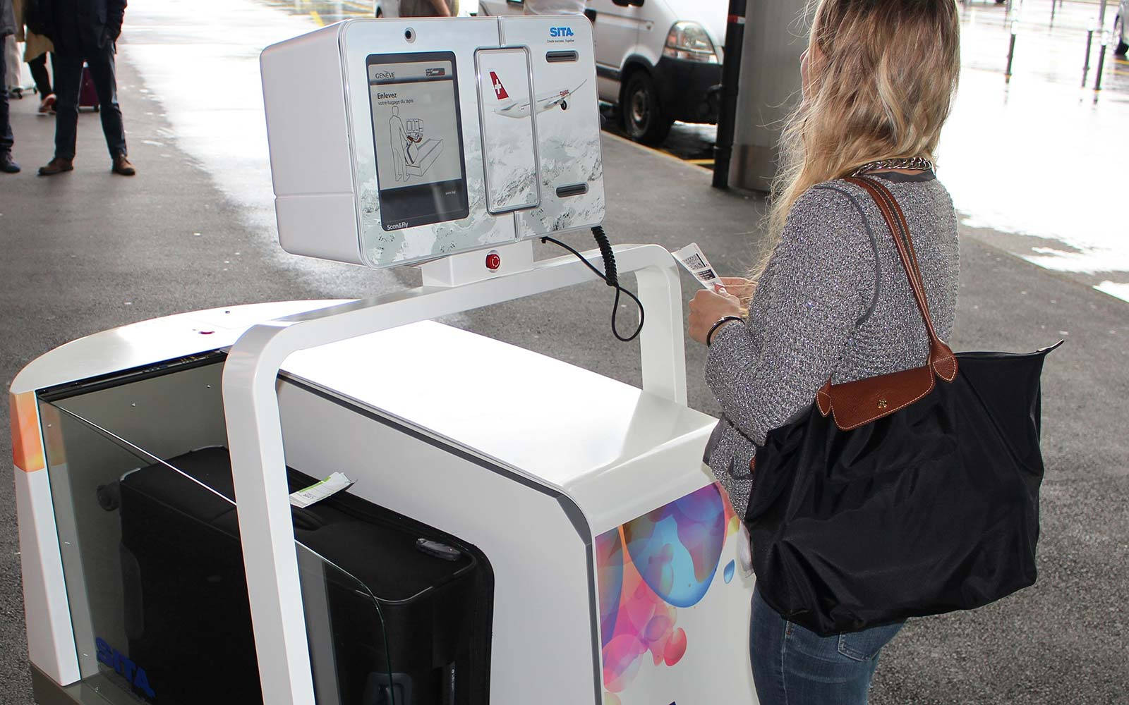 This airport robot will take your bags at the curb, check you in and send you on your way