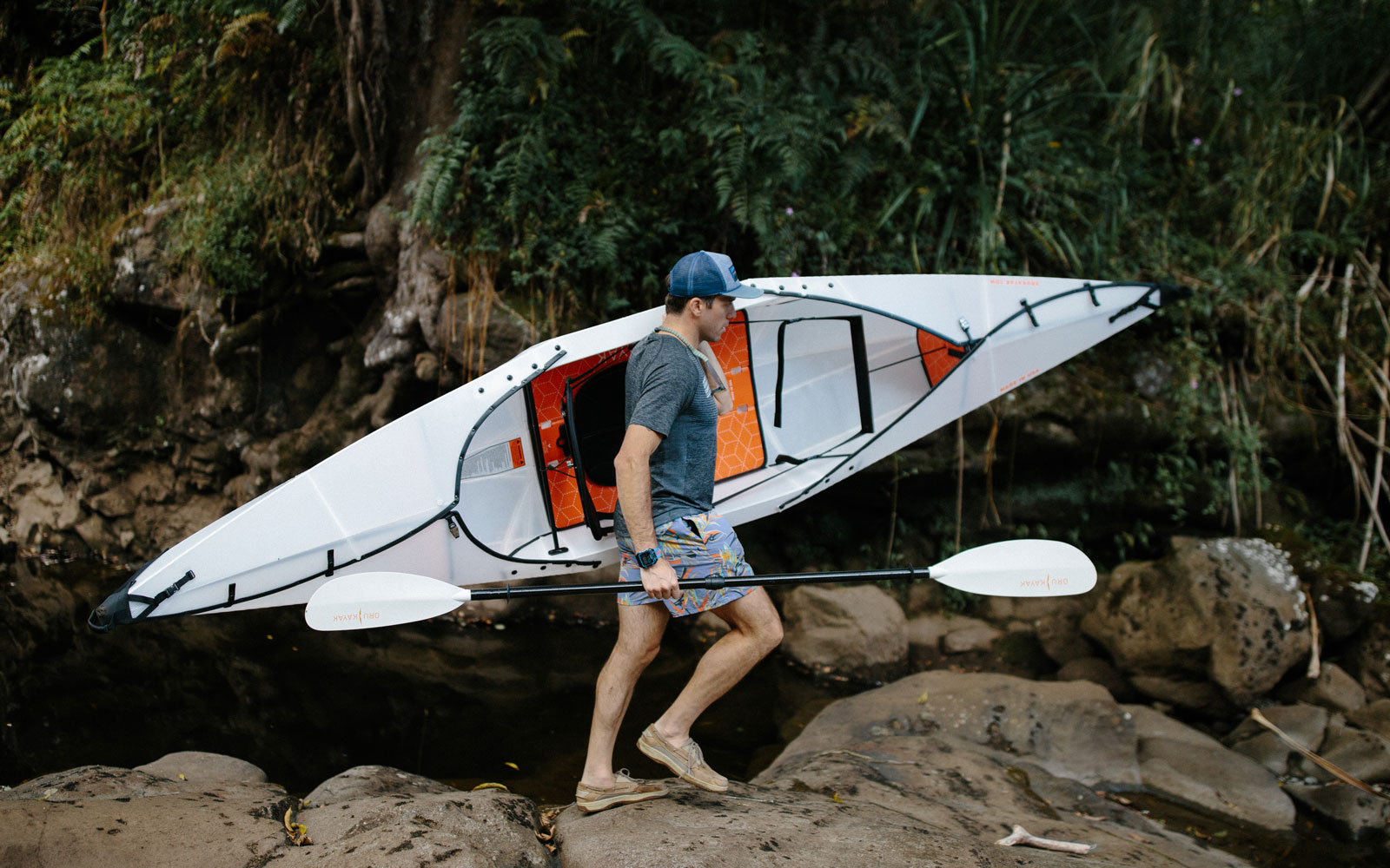 guy carrying built kayak