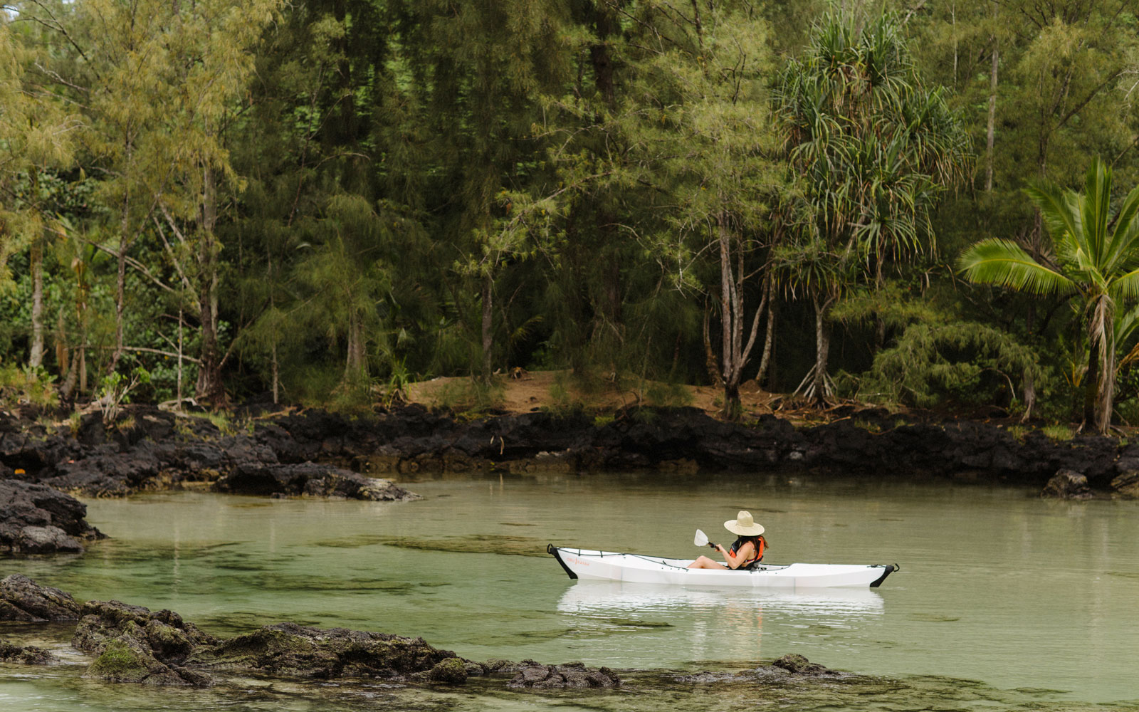 girl kayaking in water
