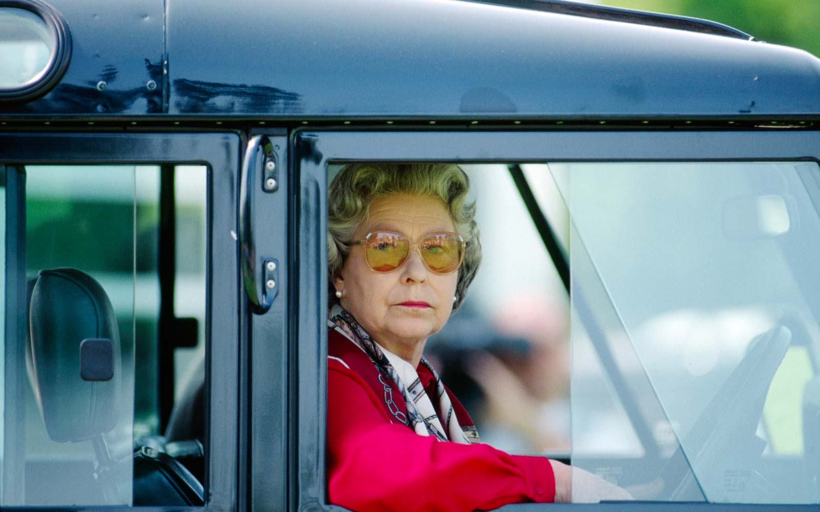 This photo of Queen Elizabeth at the wheel makes us want to join her on a road trip
