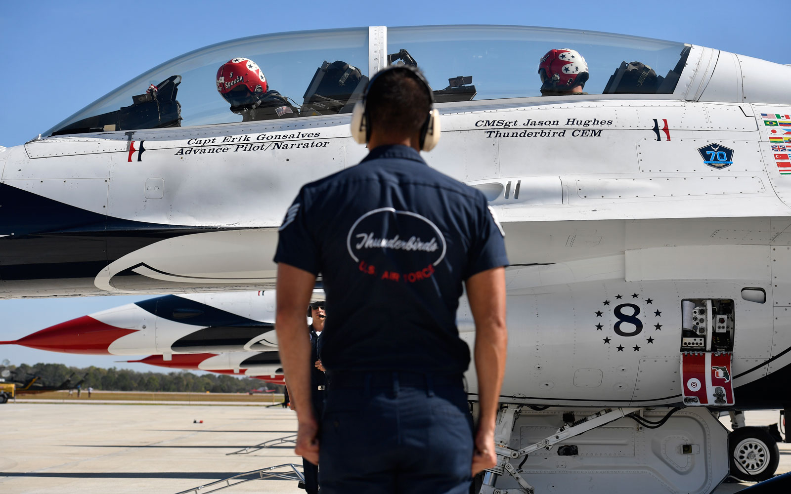 thunderbirds member in front of plane